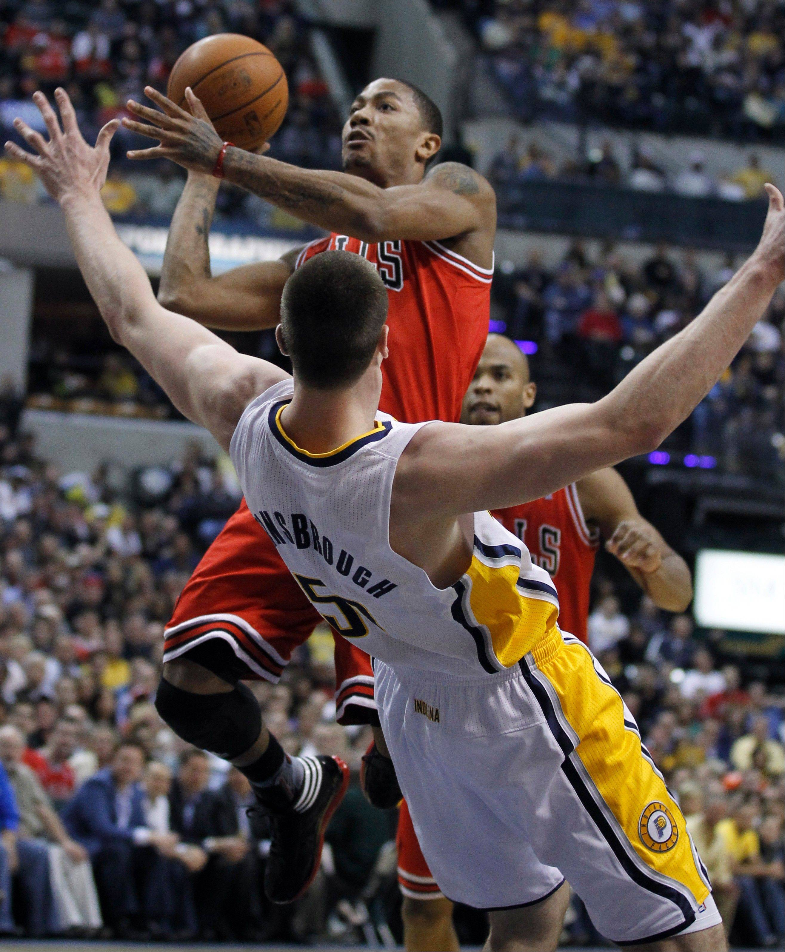 "Indiana Pacers' Tyler Hansbrough tries to draw a charging foul as Chicago Bulls guard Derrick Rose drives to the basket in a game in Indianapolis. The league has decided to crack down on players who ""flop"" in trying to trick referees into calling a charge."