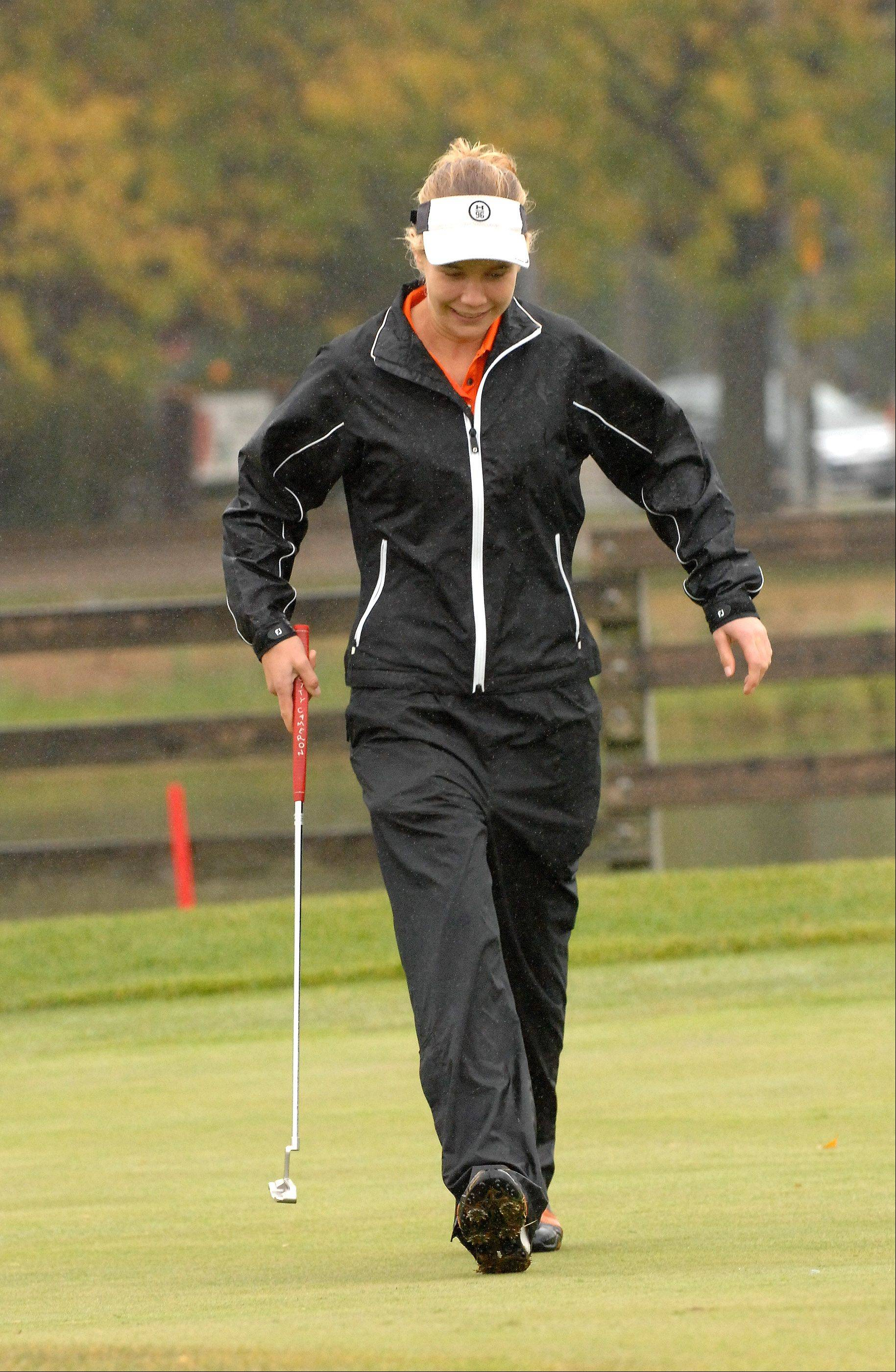 Kelly Anderson, from Wheaton Warrenville South, reacts to sinking her put on the 3rd hole at the York girls golf regional at Maple Meadows Golf Course in Wood Dale.