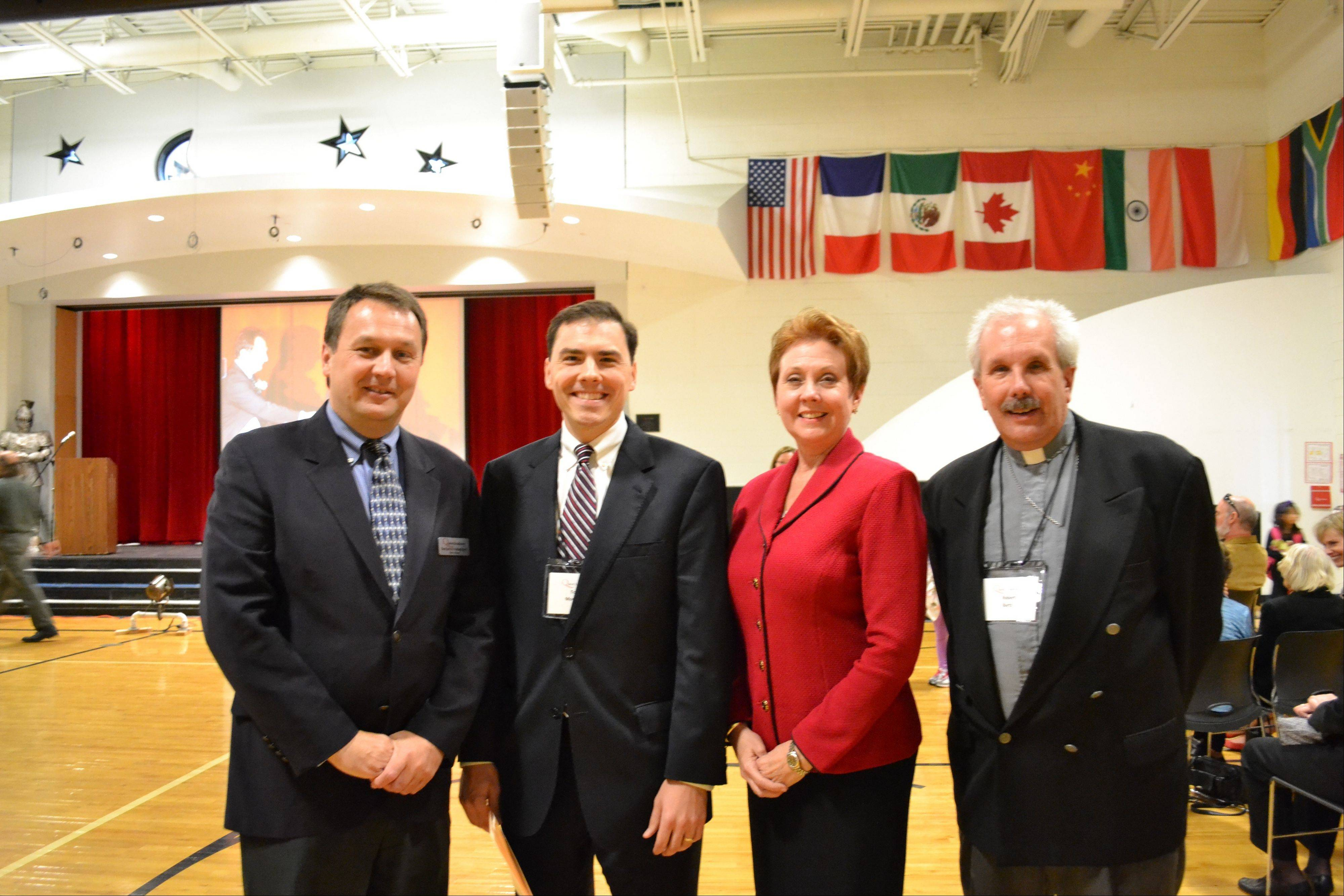Pictured, from left, are: Ben Hebebrand, head of School, Quest Academy; Tom Morrison, Illinois state representative, 54th District; Susan Paschal Bartz, daughter of Quest Academy founder Helene Bartz; and Pastor Robert Bartz, son of Quest Academy founder Helene Bartz at the character education assembly at Quest Academy.