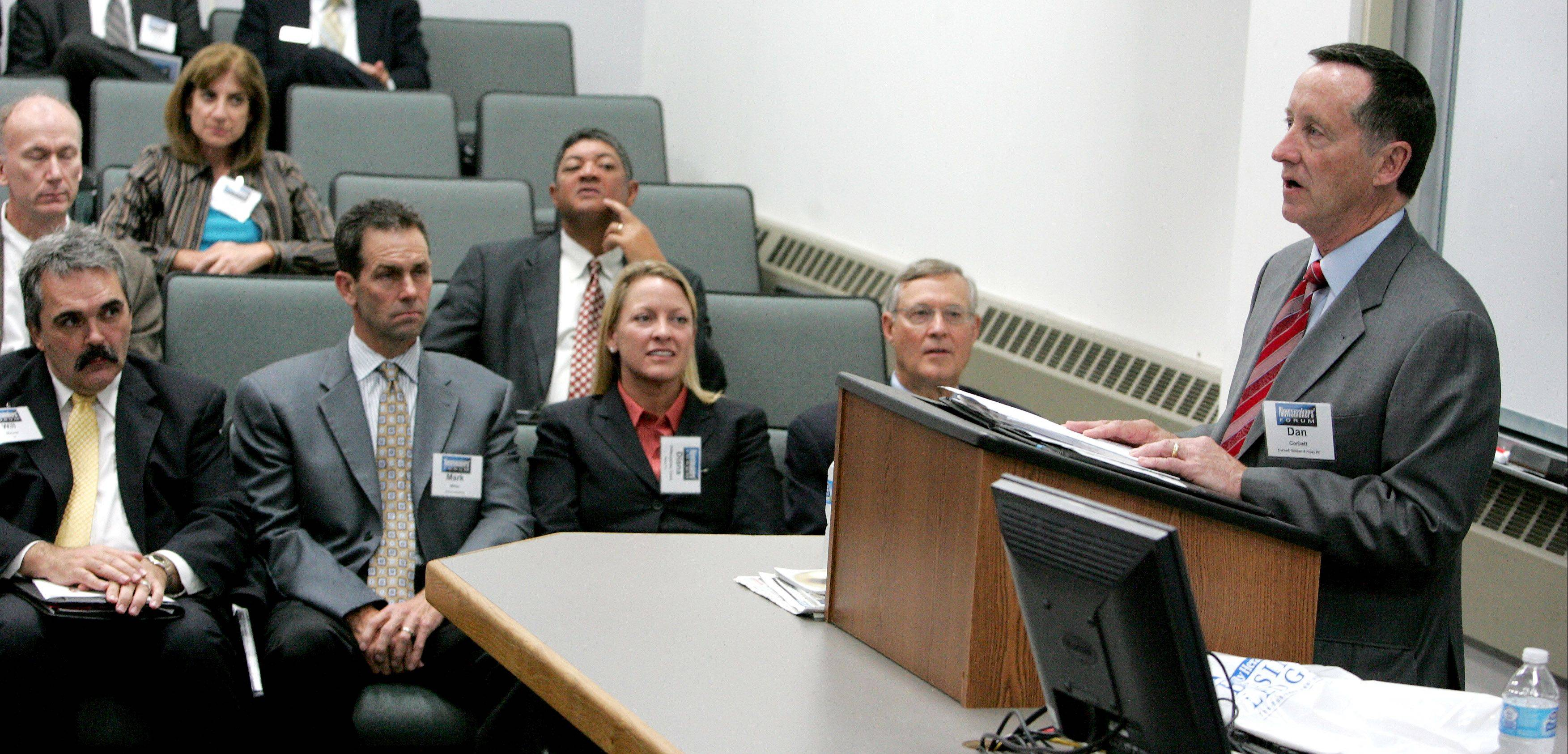 Daniel Corbett of Corbett, Duncan & Hubly PC, right, speaks at the Manufacturing and International Business Newsmakers� Forum at the Illinois Institute of Technology in Wheaton. Also on the panel were, from left, Will Mauer, Illinois Institute of Technology; Mark Miller, Prince Industries and Diana Diffendarfer Clark, Marsh Inc.