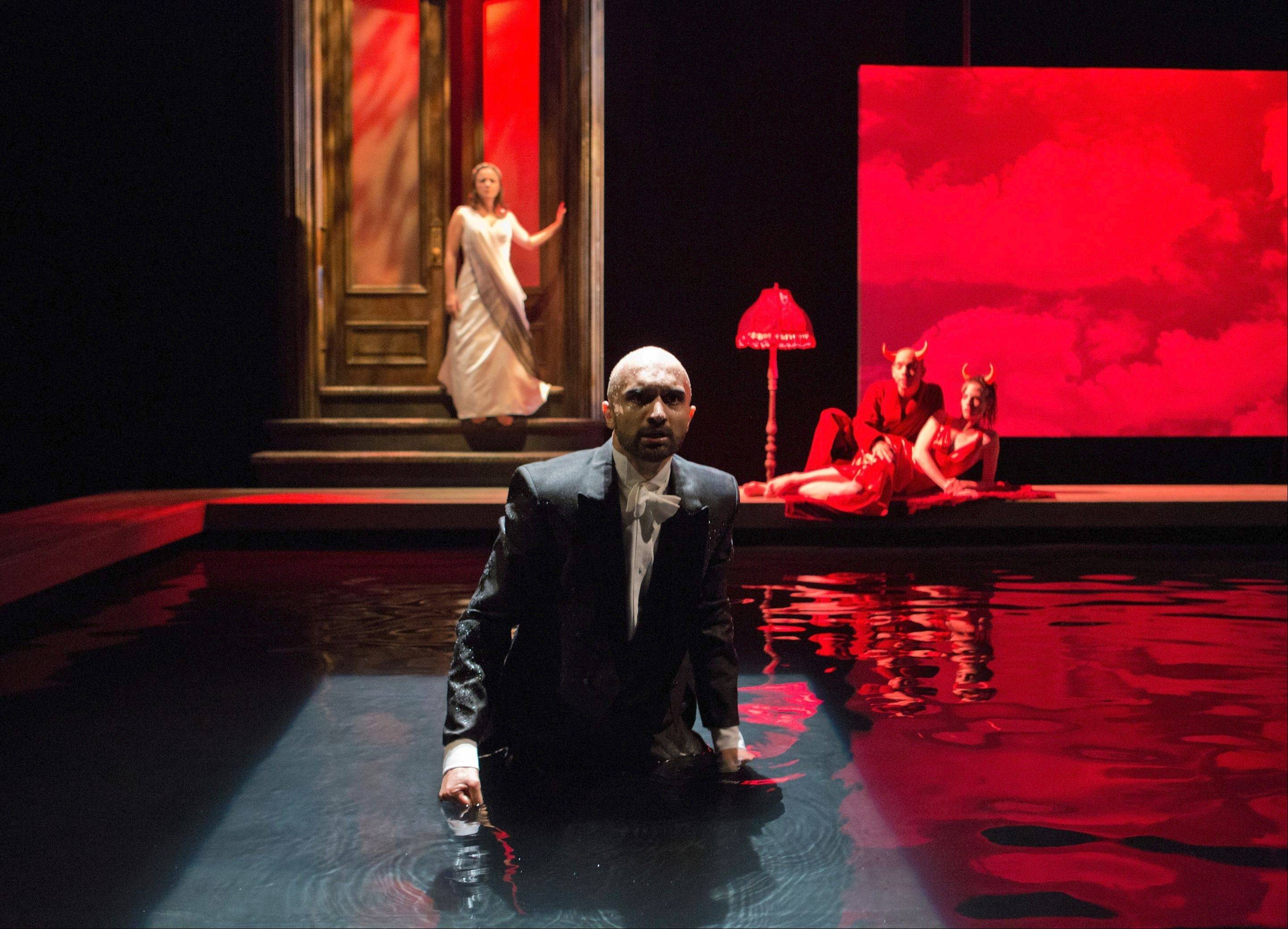 "Orpheus (Usman Ally, foreground) leaves the underworld hoping his beloved Eurydice (Lauren Orkus, on the stairs) is following him in Lookingglass Theatre's revival of Mary Zimmerman's singular ""Metamorphoses."""
