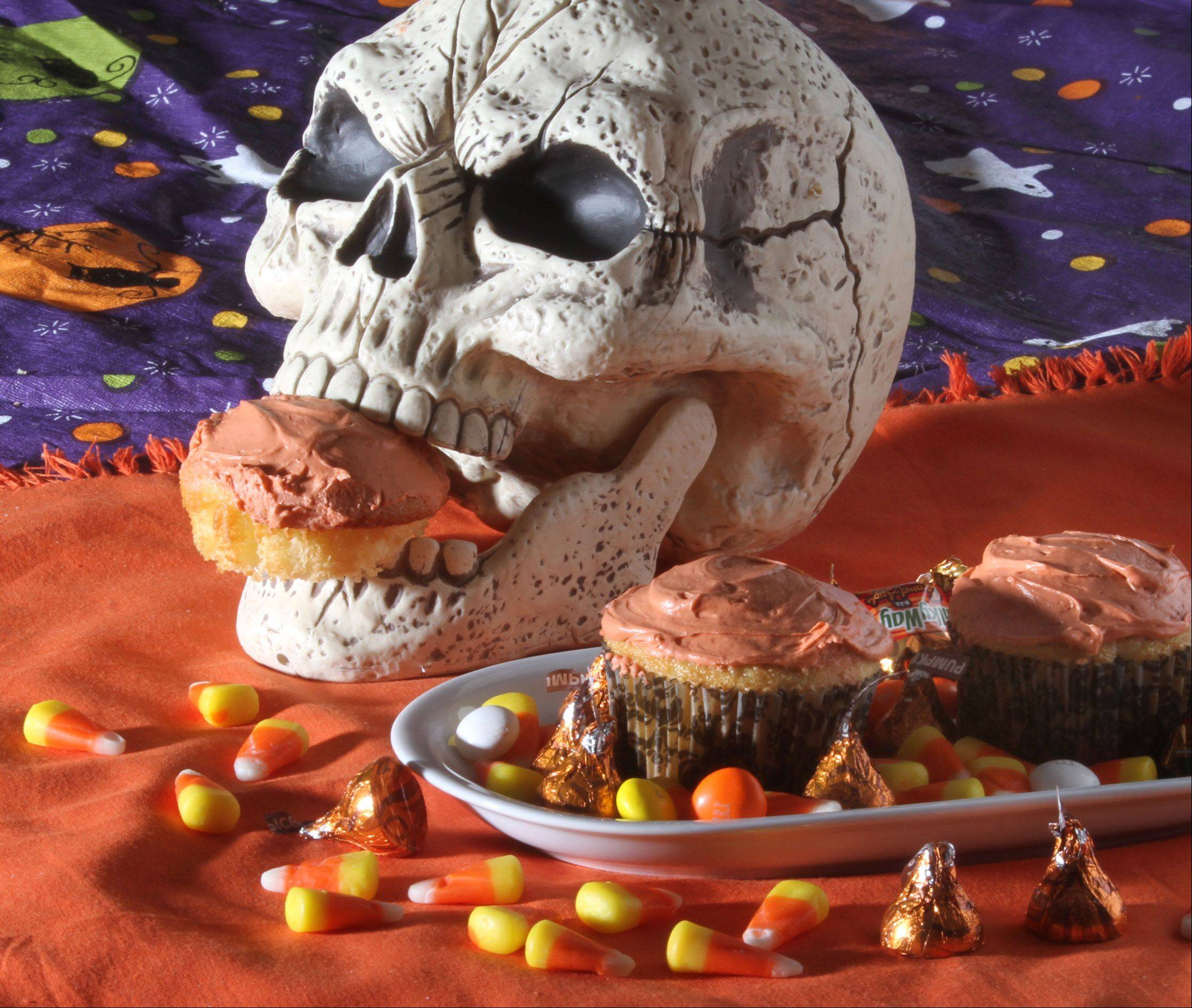 These Halloween cupcakes hold a sweet surprise: a pumpkin spice Hershey�s Kiss.
