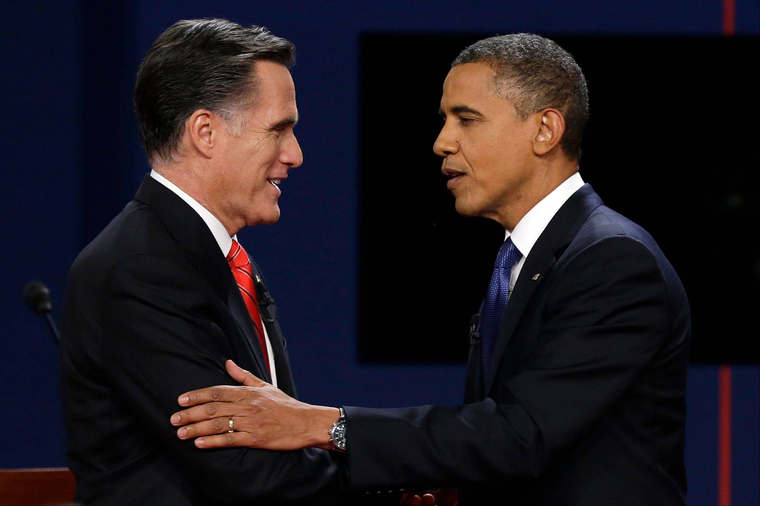 Republican presidential nominee Mitt Romney and President Barack Obama shake hands Wednesday after the first presidential debate at the University of Denver, in Denver. Both men relished the wonky talk, but Mitt Romney also showed the easy confidence a presidential contender needs � and a bit of the salesman�s dynamic presentation.