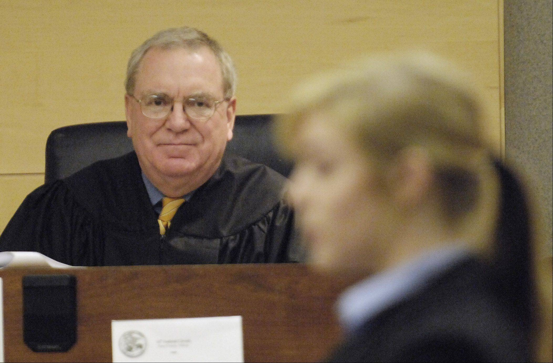 Judge Allen Anderson, presiding over a mock trial at the Kane County Judicial Center, said he will retire at the end of the year.