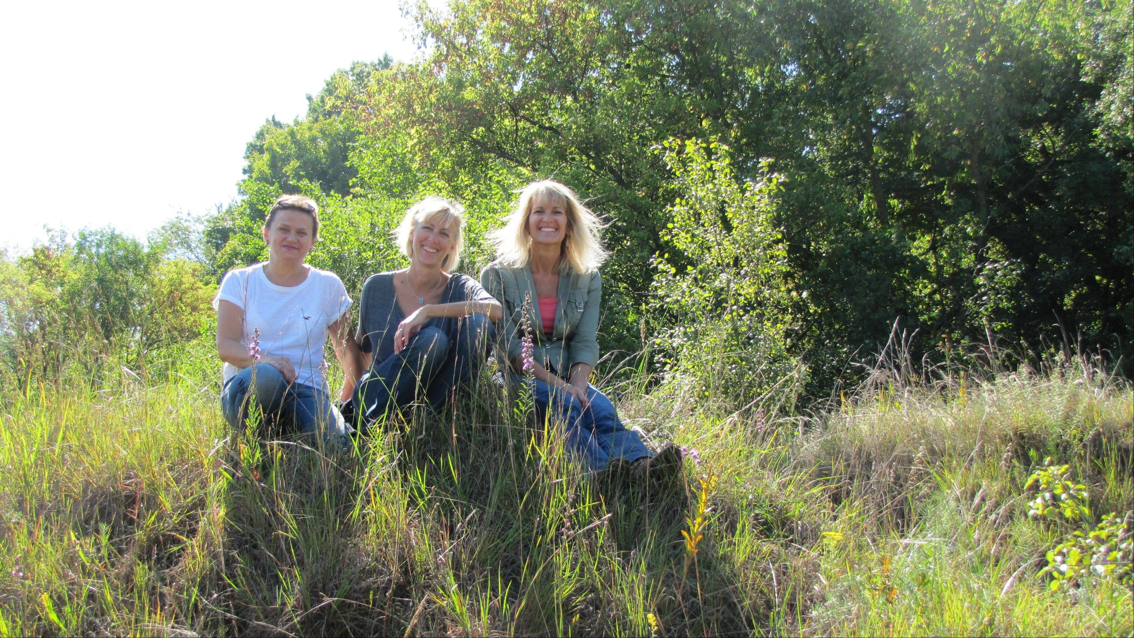 Landowner Renata Heiberg, left, sits atop the gravel hill prairie with Barrington Area Conservation Trust Land Protection Specialist Lisa Woolford and Executive Director Karen Yancey.