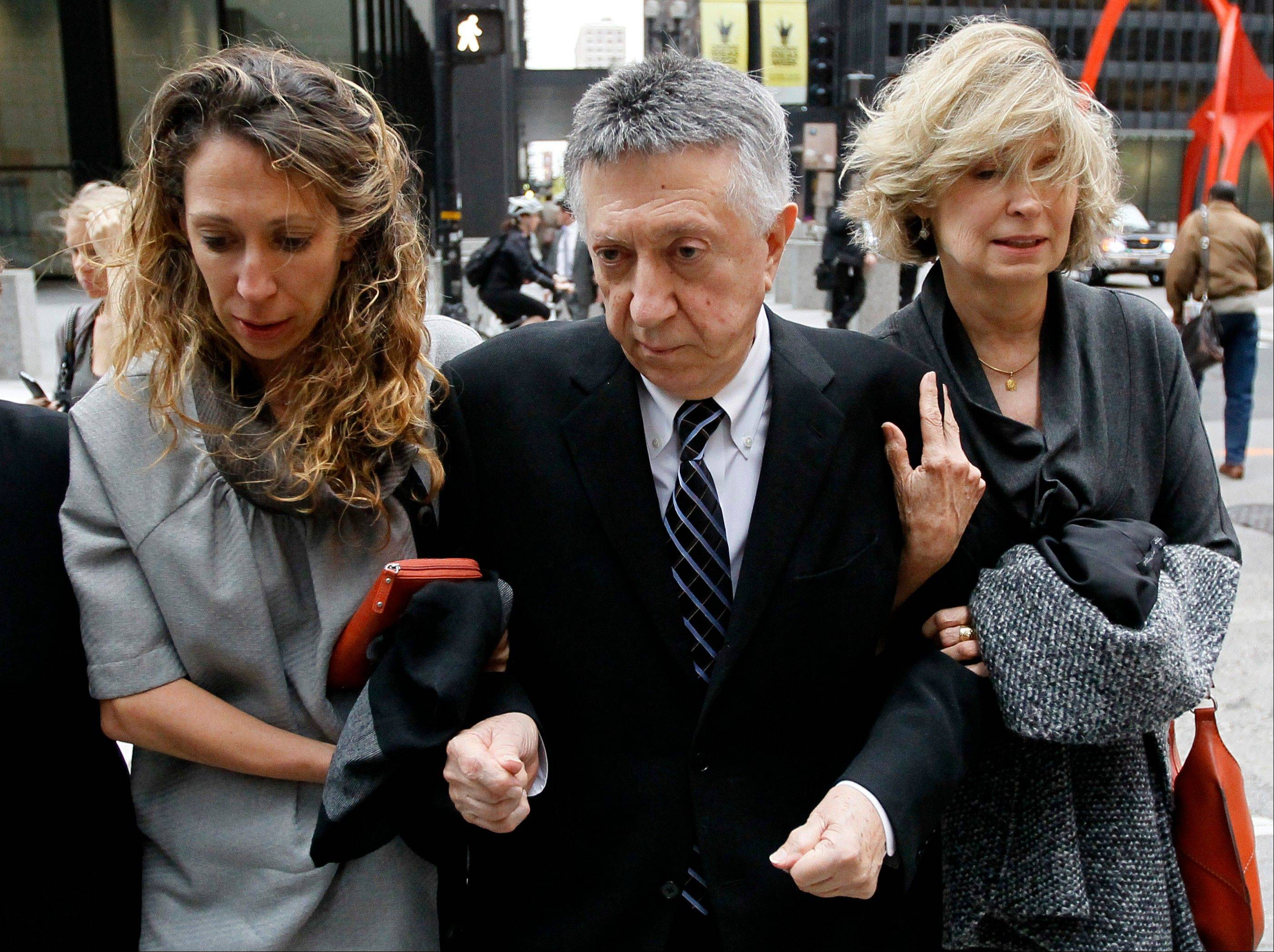 William Cellini, center, leaves the federal courthouse with unidentified family members after Judge James Zagel sentenced him to 366 days in prison and a $75,000 fine Thursday in Chicago.