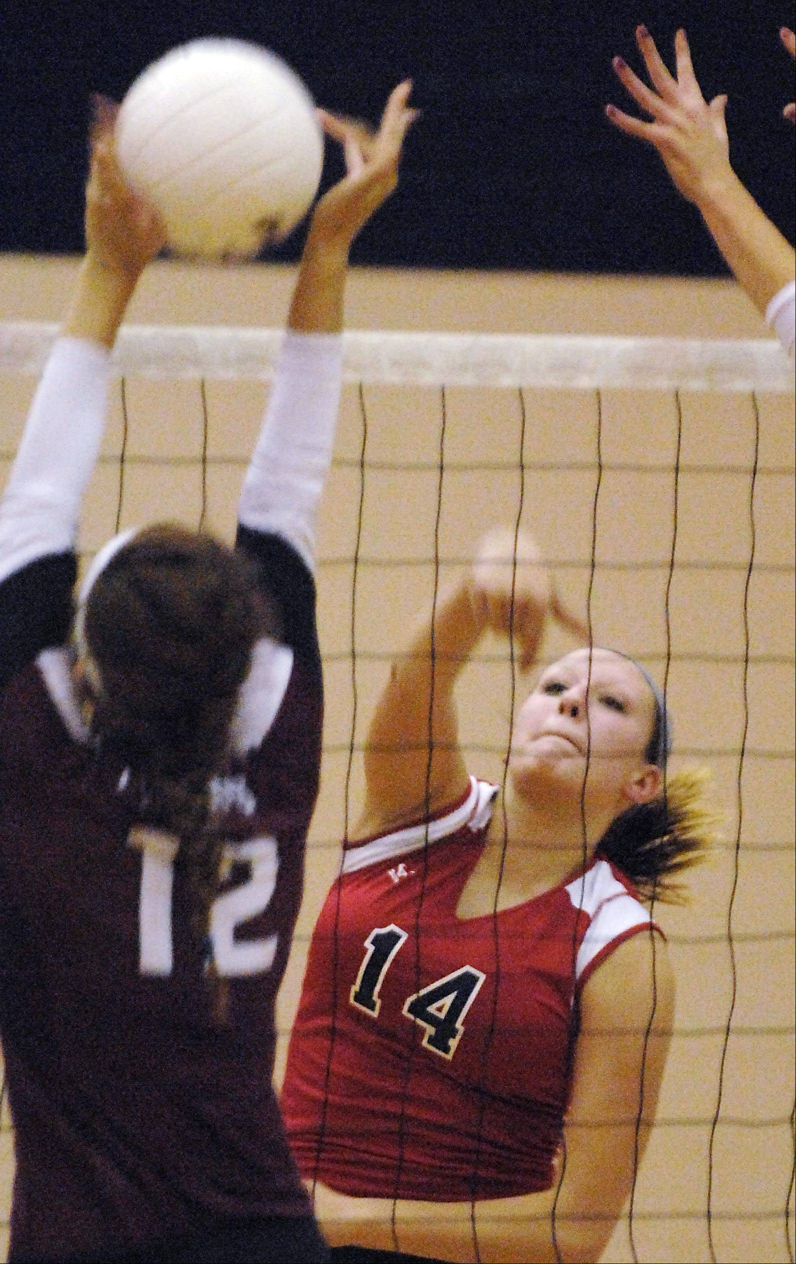 Elgin's Emma Sirridge slows down a spike by South Elgin's Alyssa Montag Thursday in South Elgin.