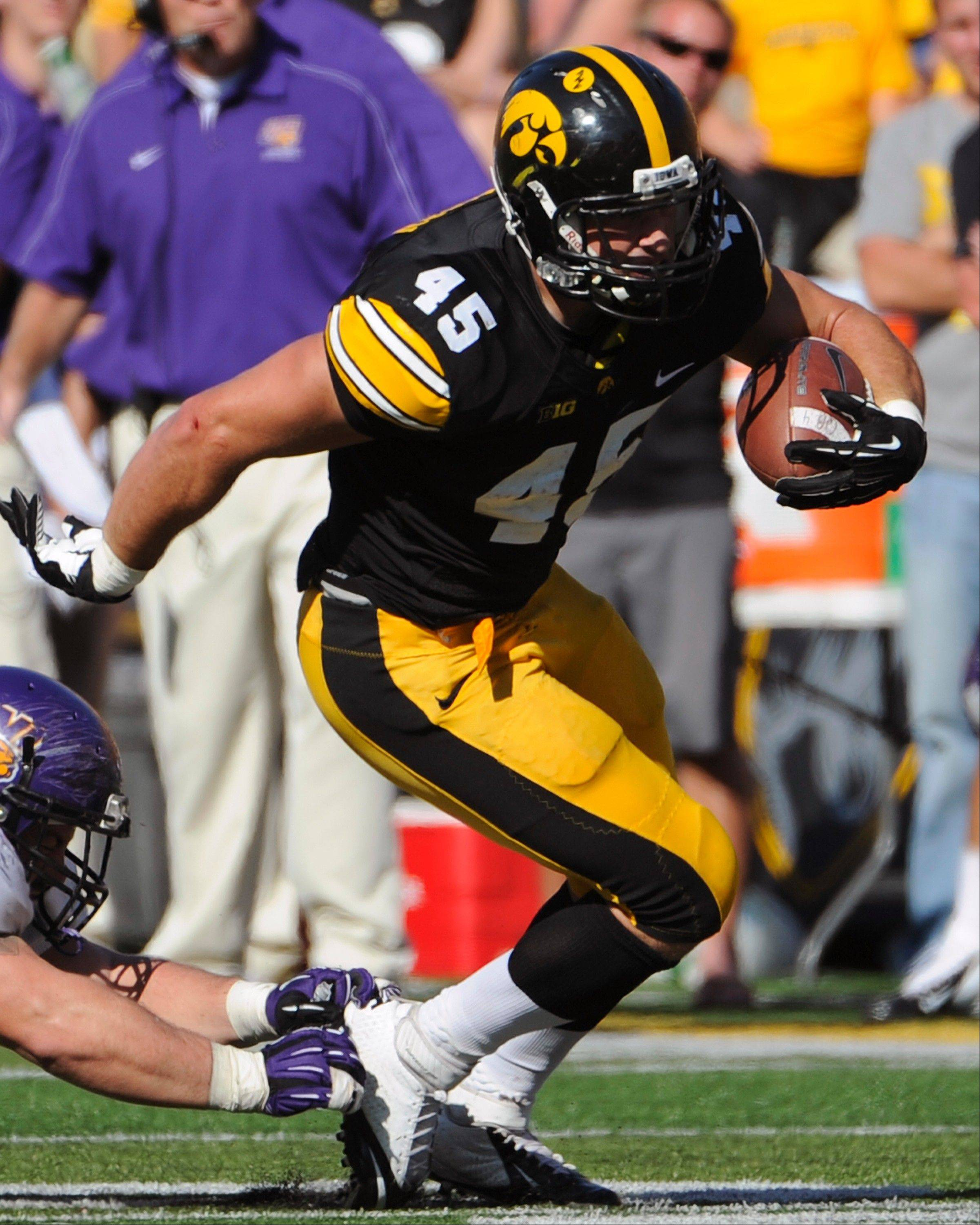 Stevenson product Mark Weisman has beaten the odds by becoming a standout in Iowa's backfield.