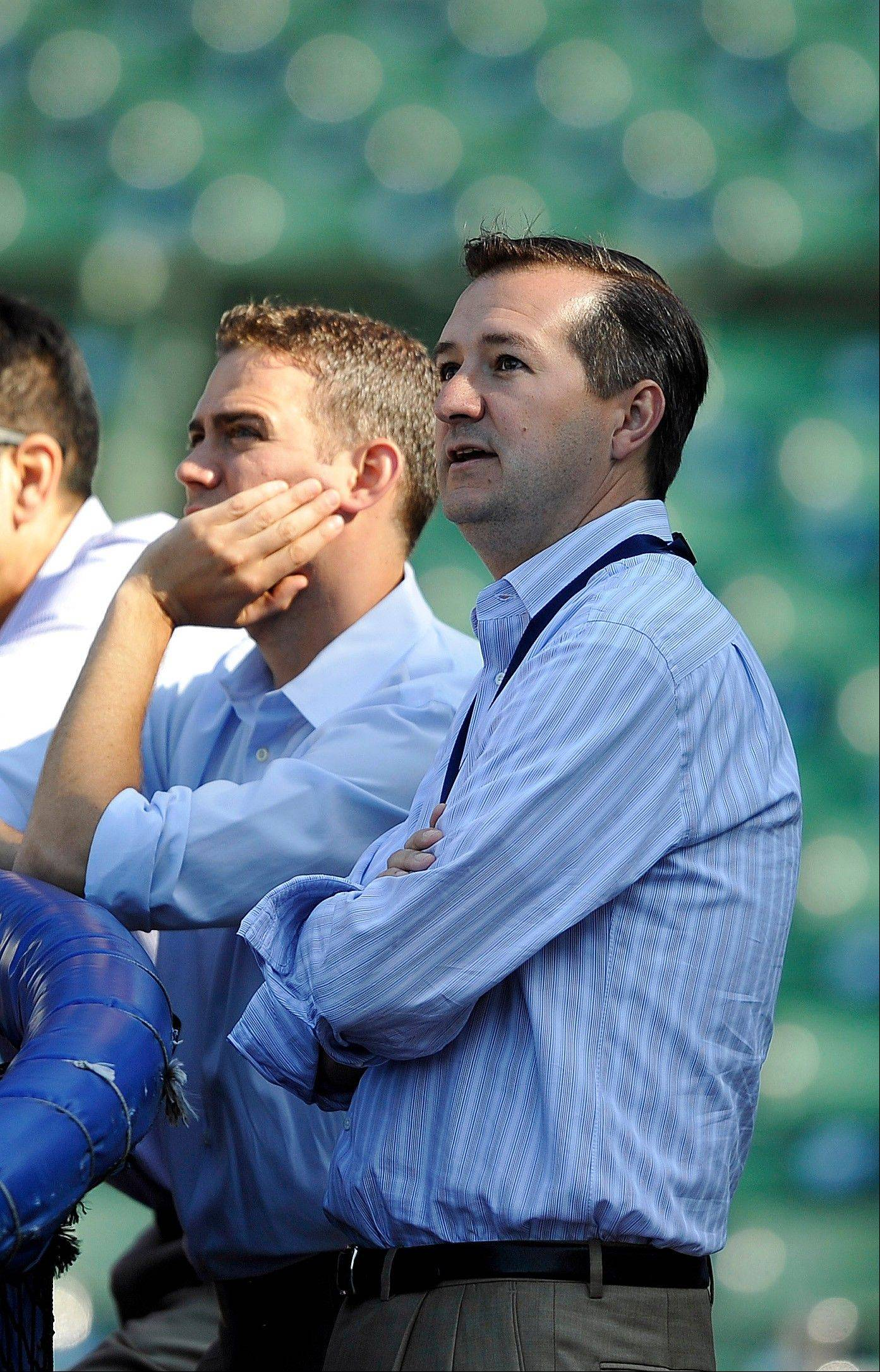 In this June 26, 2012, file photo, Cubs president Theo Epstein left, and chairman Tom Ricketts watch batting practice before a game against the New York Mets at Wrigley Field.