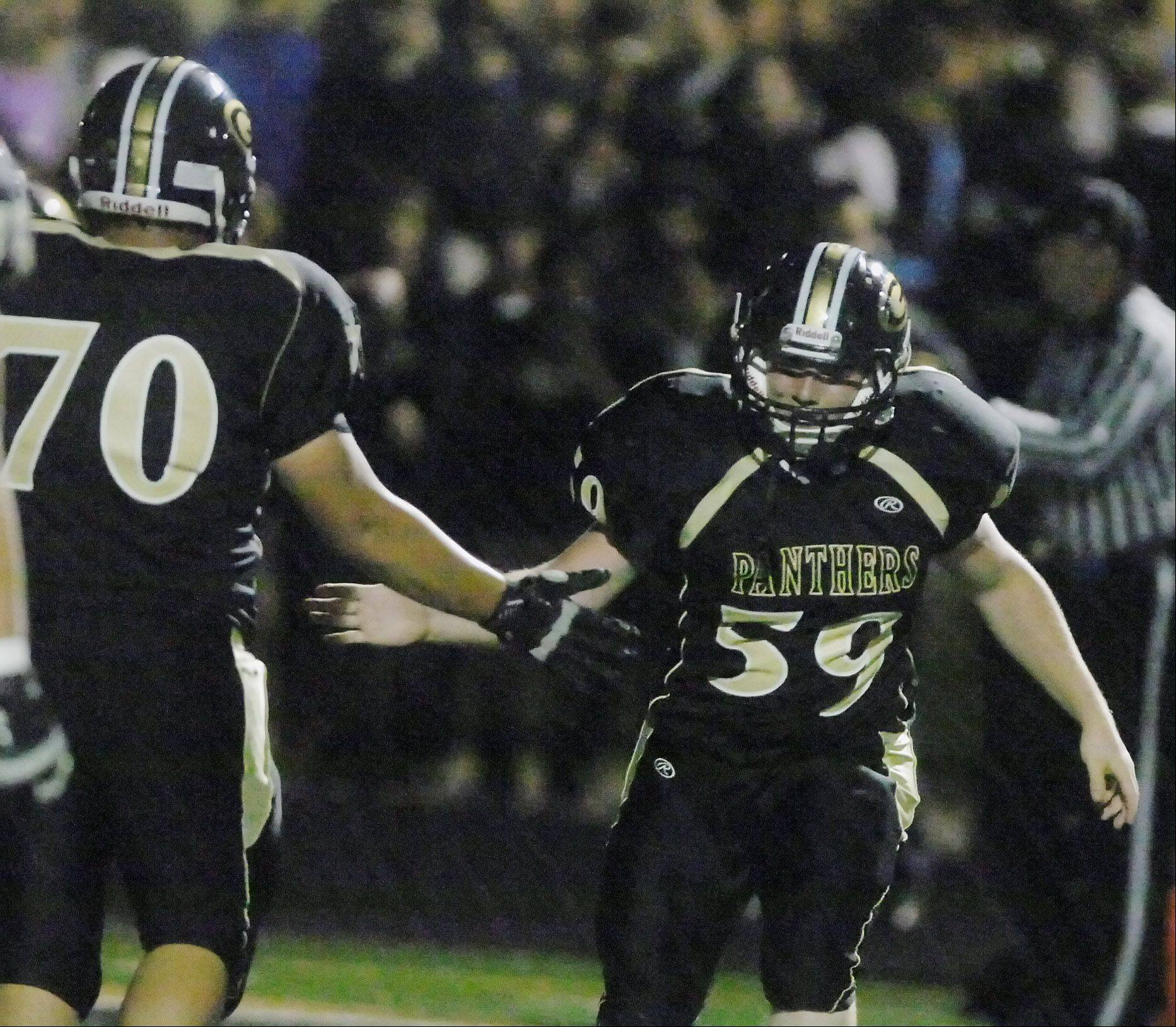 Mitch Siver,left, and Ethan Hernandez both of Glenbard North celebrate after a TD during game action Friday against Naperville Central.