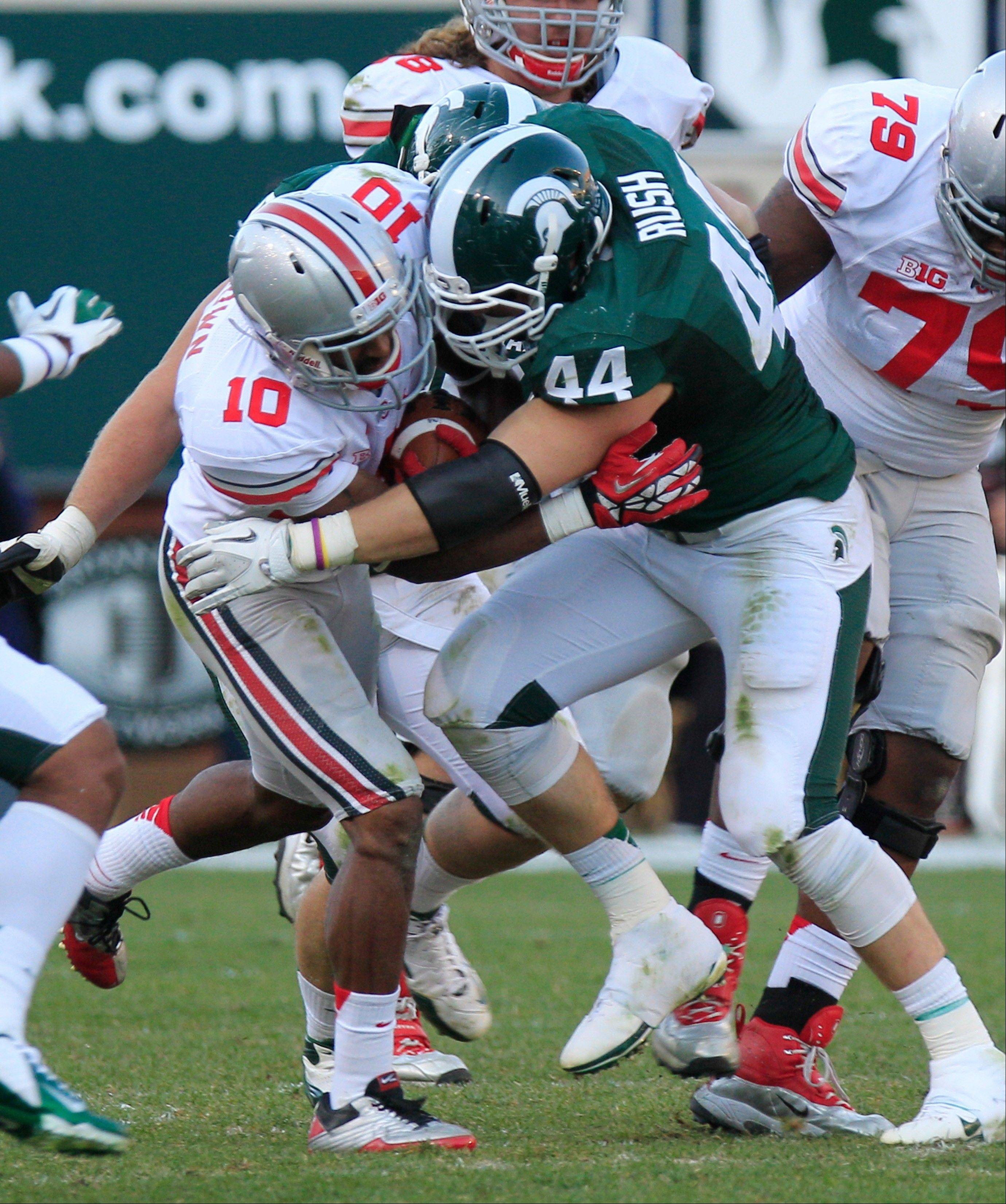 Ohio State wide receiver Philly Brown tries to get away from Michigan State defensive end Marcus Rush last Saturday in in East Lansing, Mich.