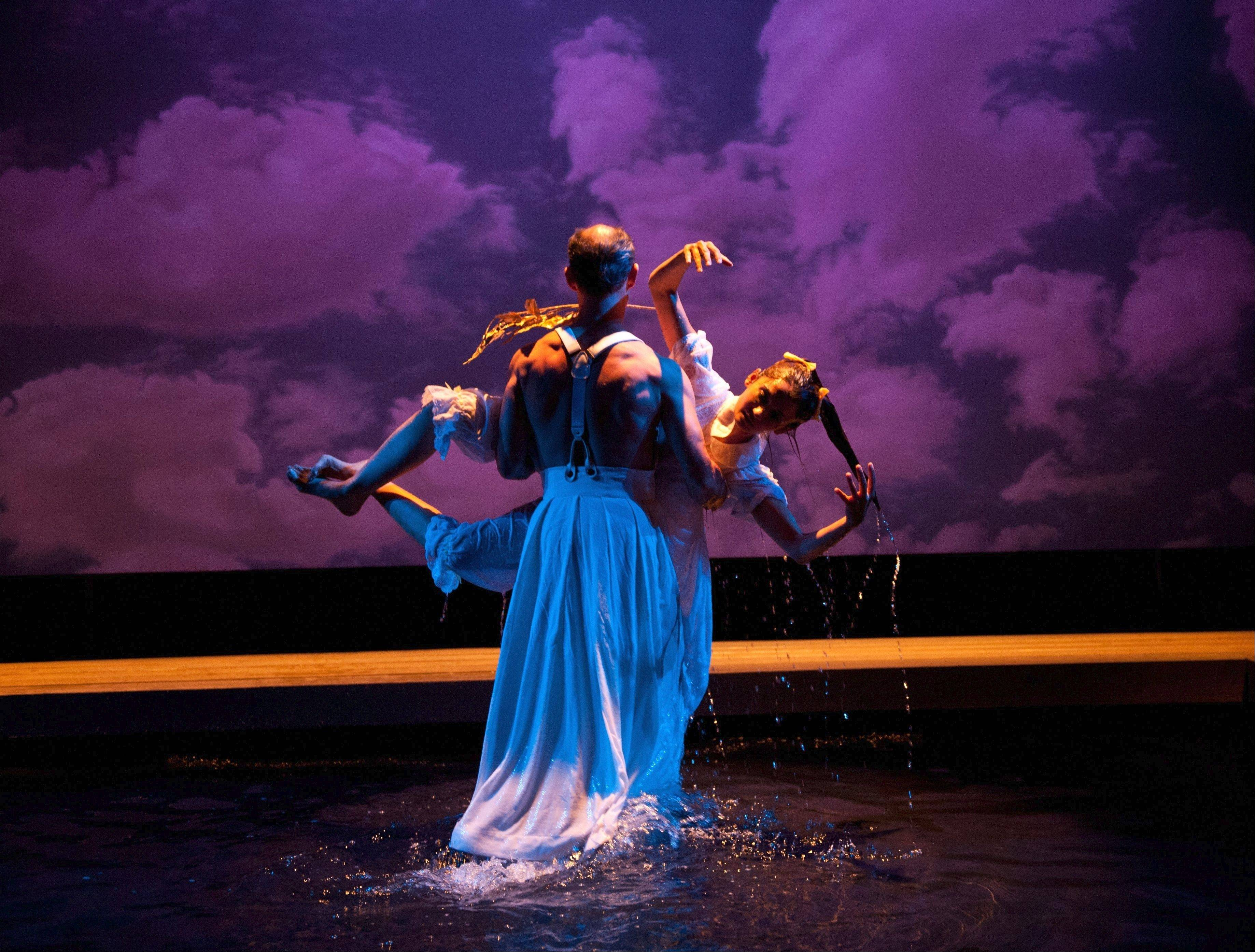 "One of the gods carries away the daughter of King Midas (Anjali Bhimani), turned to gold as the result of a foolish wish in Mary Zimmerman's ""Metamorphoses"" at Lookingglass Theatre."