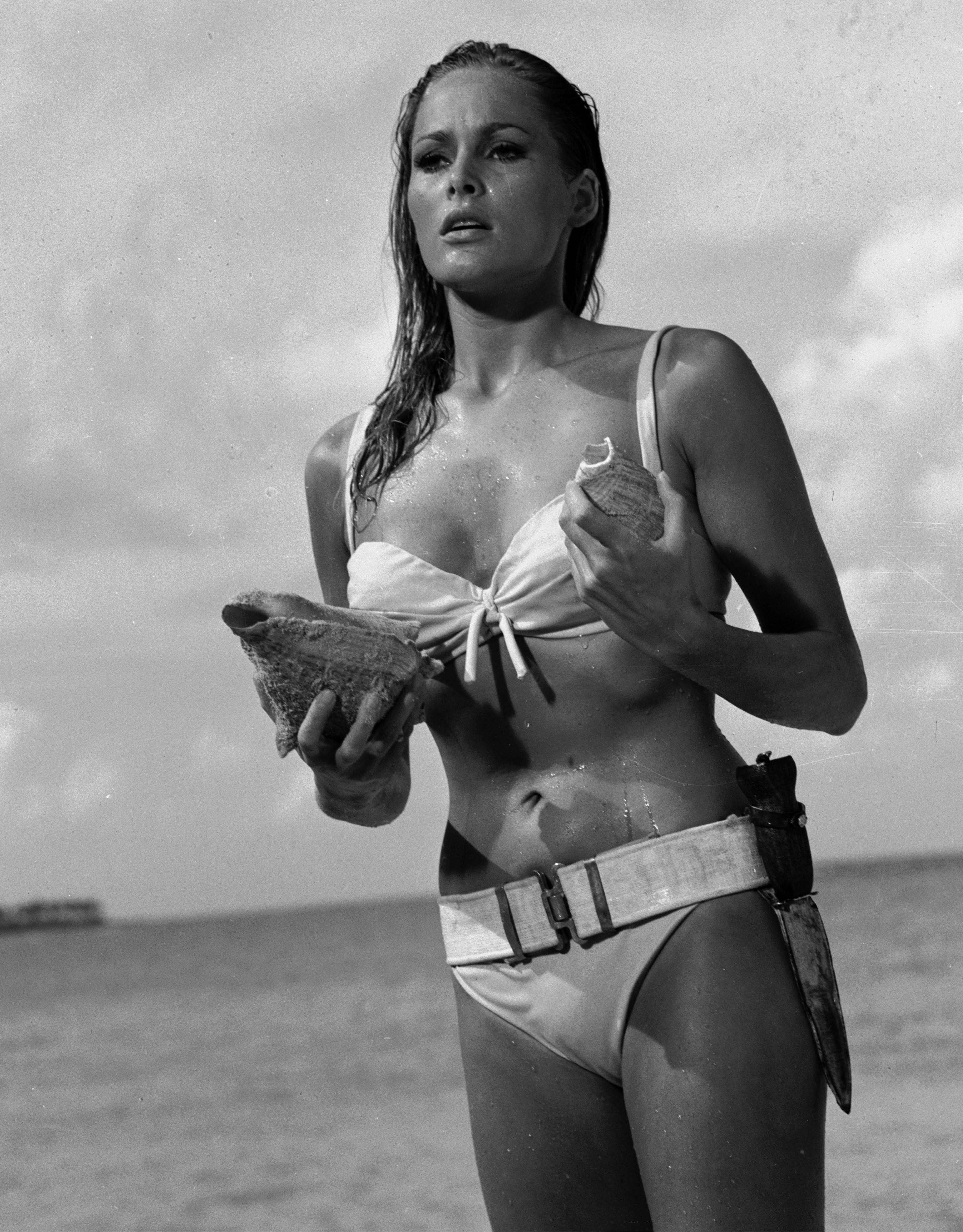 "In the James Bond 1962 film, ""Dr. No,"" Ursula Andress emerged from the sea, curves glistening, with a dagger strapped to her bikini. She made the Bond girl an instant icon."