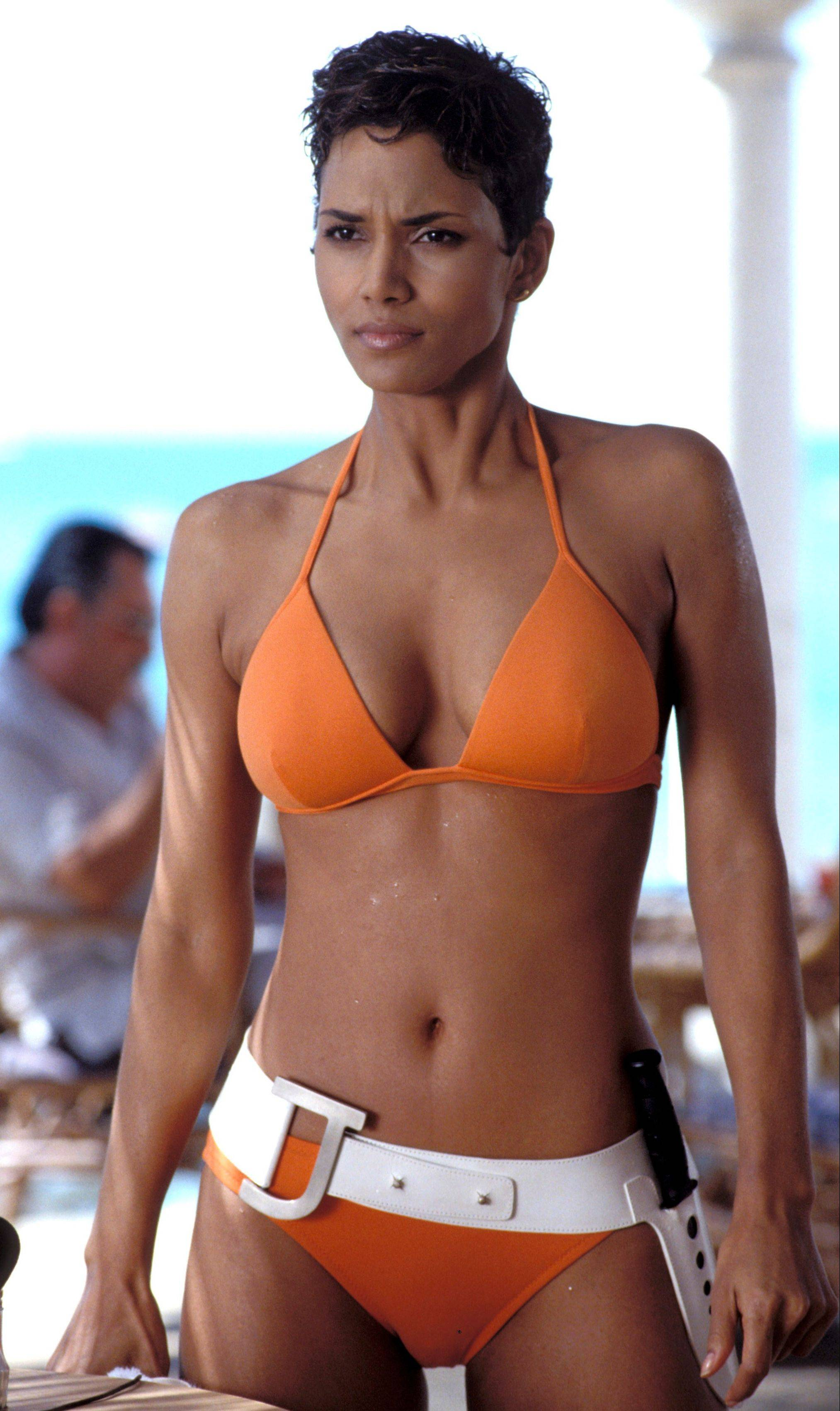 "Halle Berry, in the 2002 film, ""Die Another Day,"" used her wiles to outsmart James Bond."