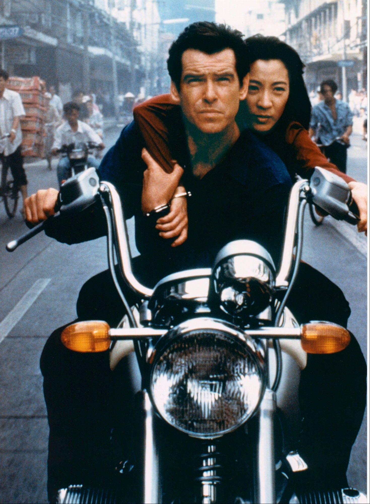 "Pierce Brosnan, as James Bond, and Michelle Yeoh, as Wai Lin, in a scene from the James Bond 1997 movie ""Tomorrow Never Dies."""
