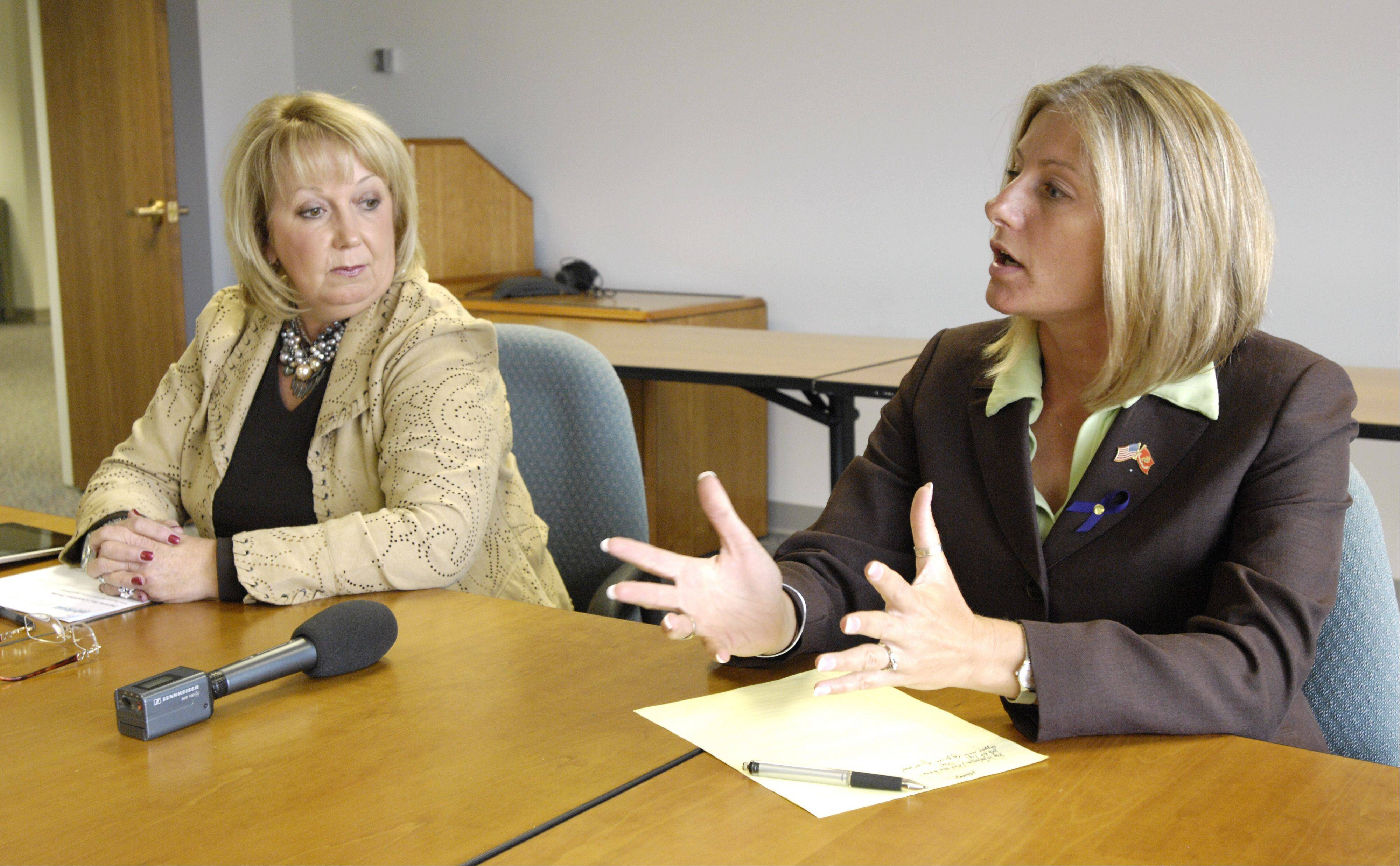 Democrat Stephanie Kifowit, right, speaks to the Daily Herald about issues facing the 84th state House District in the Aurora area. Kifowit is facing Republican Pat Fee in a race for the seat in the Nov. 6 election.