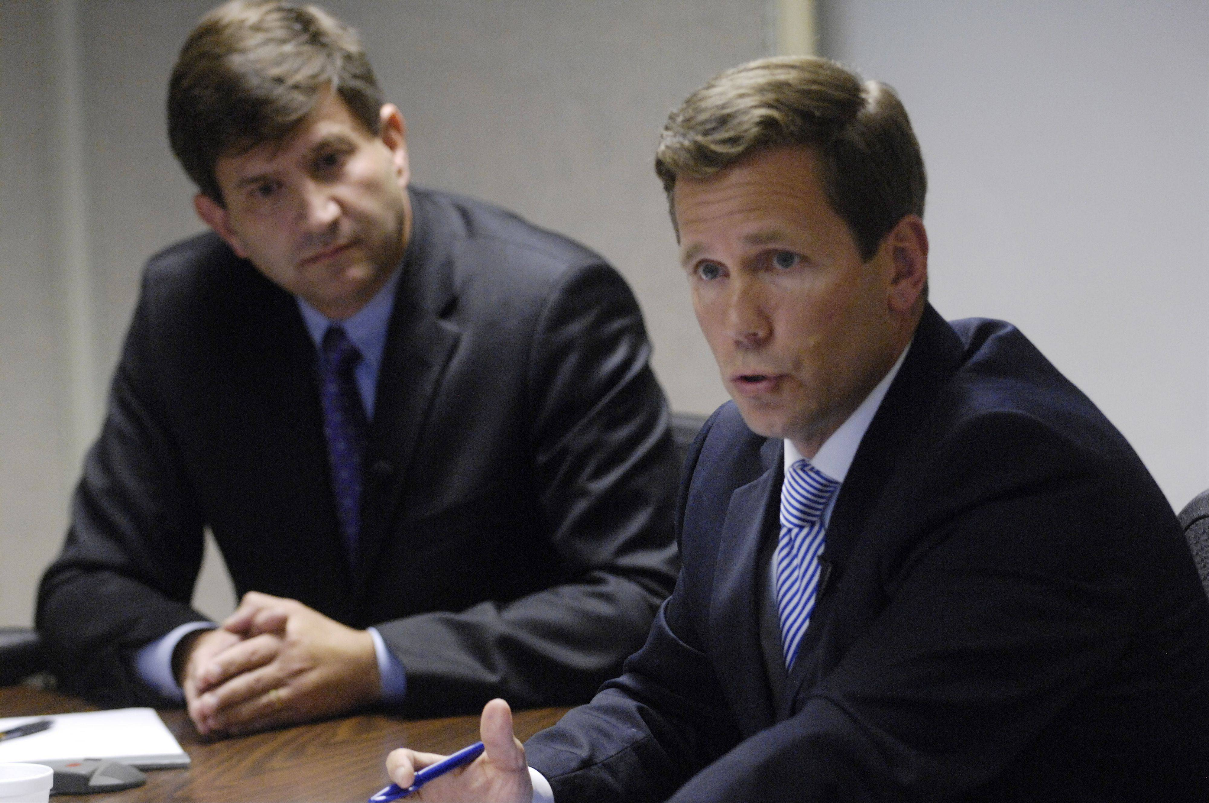 Republican incumbent Robert Dold, right, speaks as Democratic challenger Brad Schneider looks on during a meeting with the Daily Herald Editorial Board Wednesday. They are running in the 10th Congressional District.