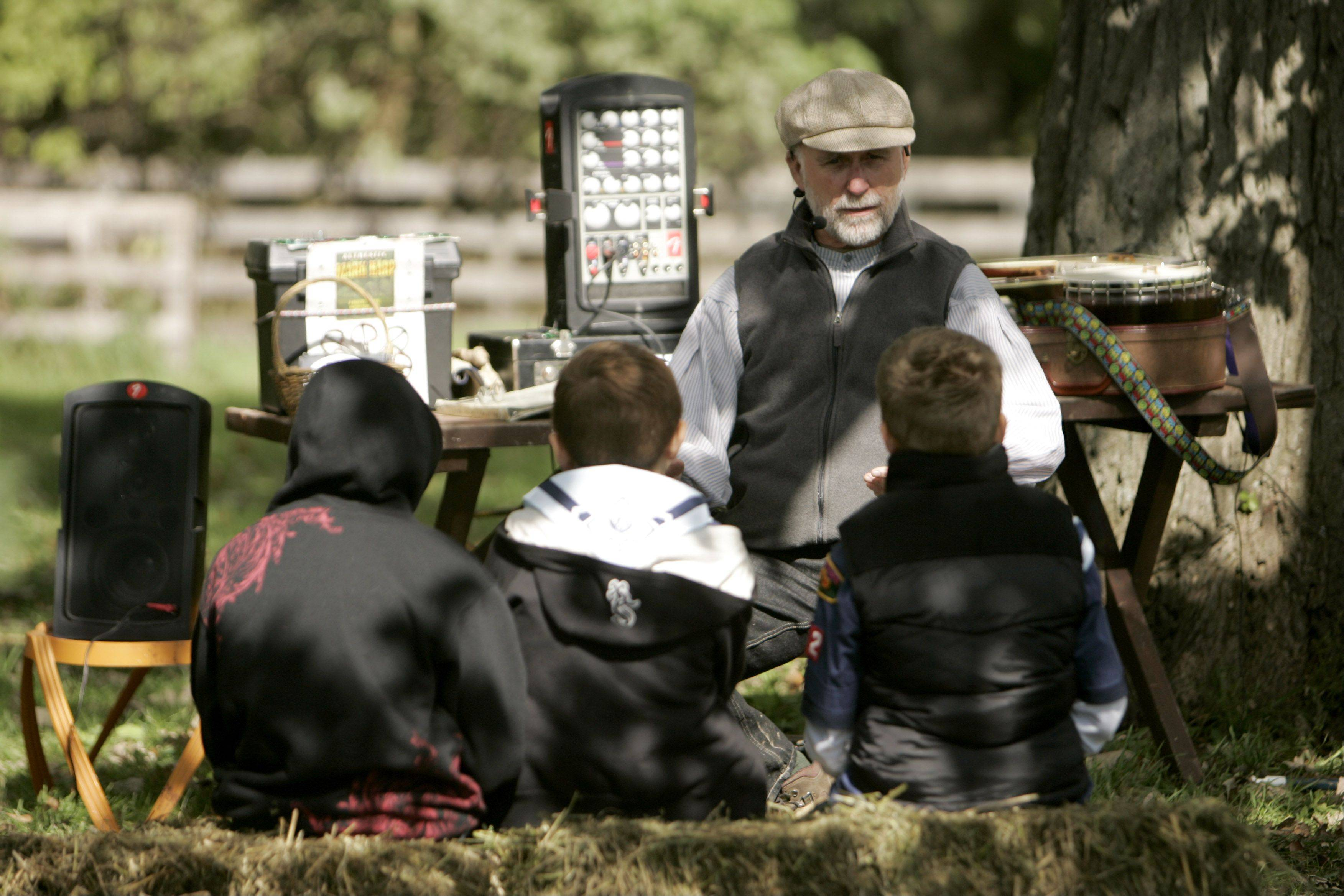 Storyteller Reid Miller of Stoughton, Wis., entertains children during Garfield Farm Museum's annual Harvest Days.