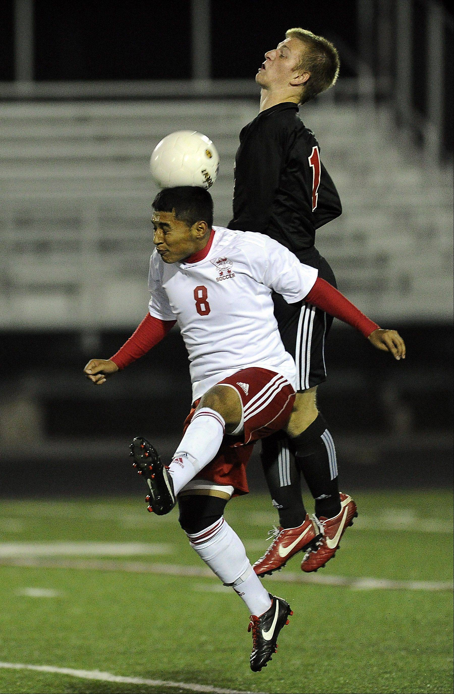 Palatine's Cesar Valdez tries to get control of the ball with a header while Barrington's Dylan Nelson applies pressure Thursday at Palatine.