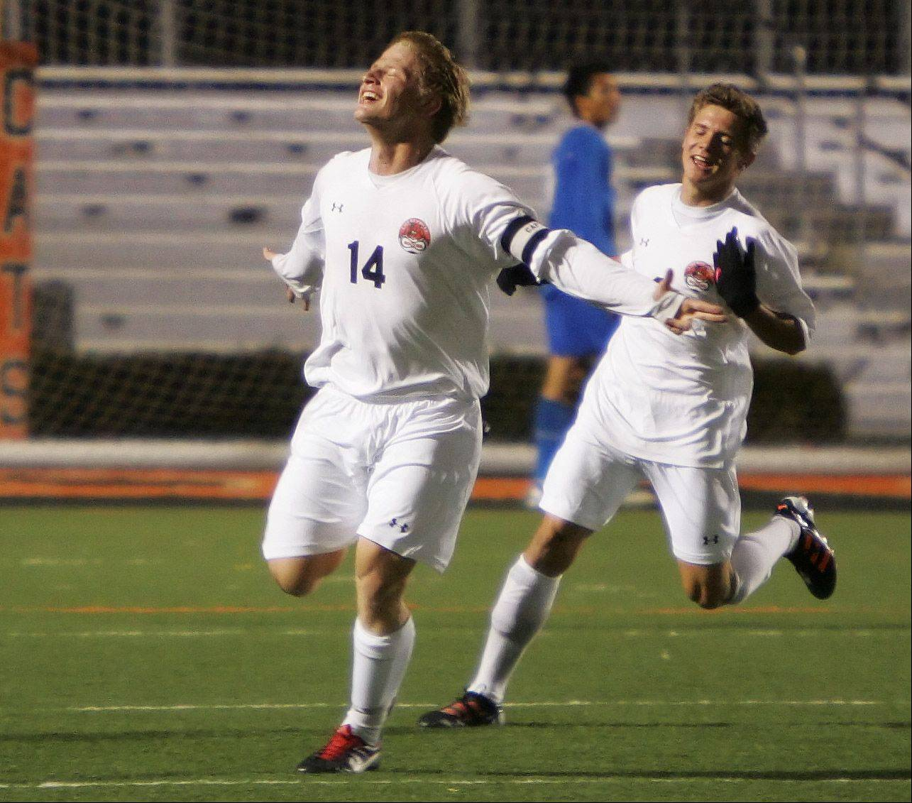 Libertyville forward Lloyd Chatfield III celebrates after scoring the first Thursday against Warren at Libertyville. Libertyville's Ralf Zehnter is to the right.