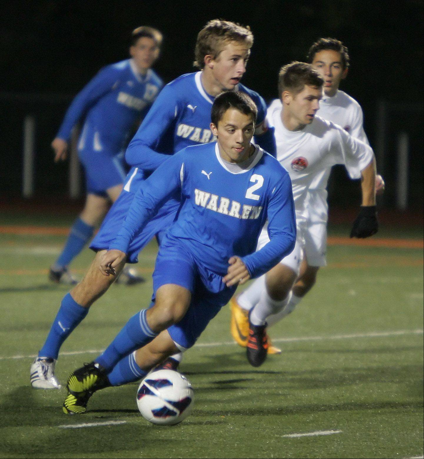 Warren forward Tony Severini takes the ball down field Thursday at Libertyville.
