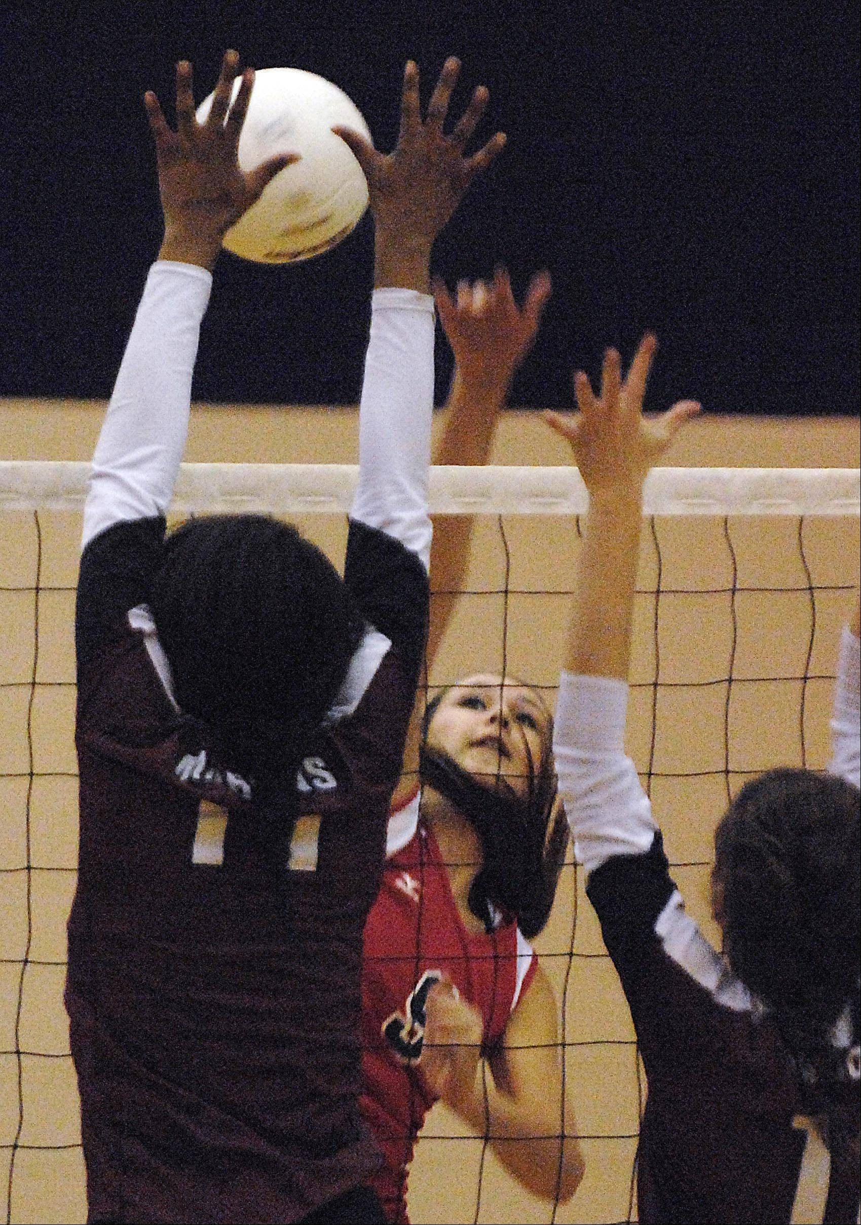 Elgin's Abbey Pierre-Louis and Sarah Kish try to block South Elgin's Bri Reum Thursday in South Elgin.