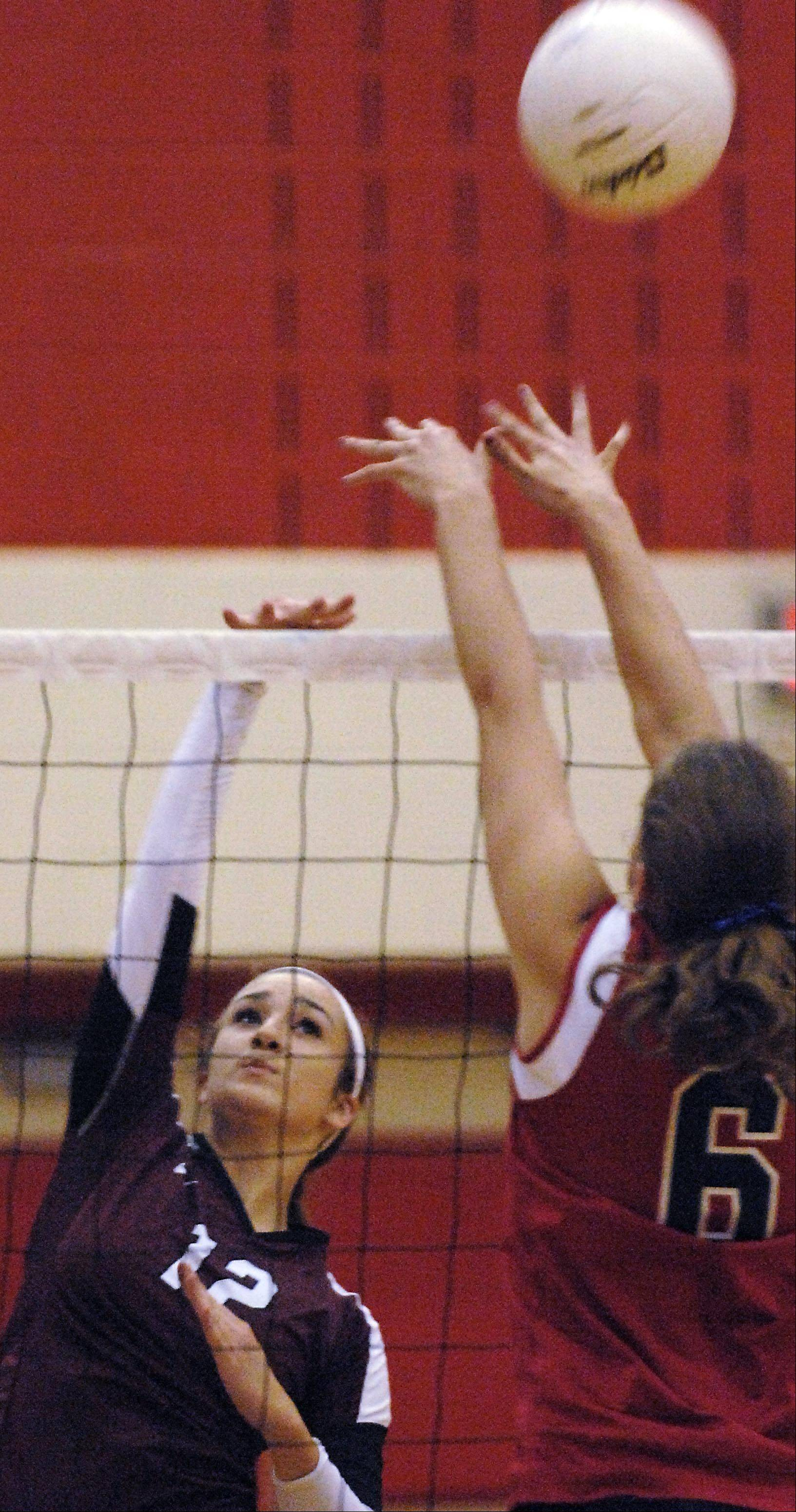 Elgin's Emma Sirridge gets the ball over South Elgin's Amanda Nadler Thursday in South Elgin.