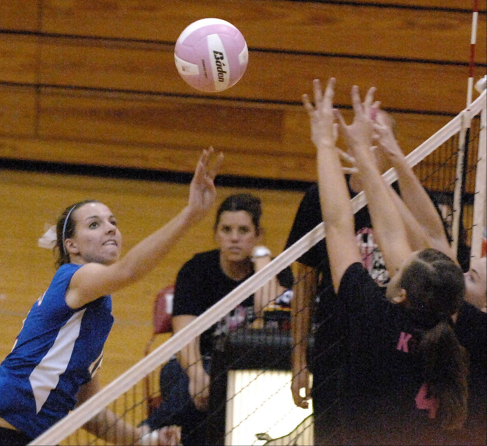 Glenbard South's Anna Watterson dinks the ball over a pair of Batavia blockers during Thursday's game at Batavia.