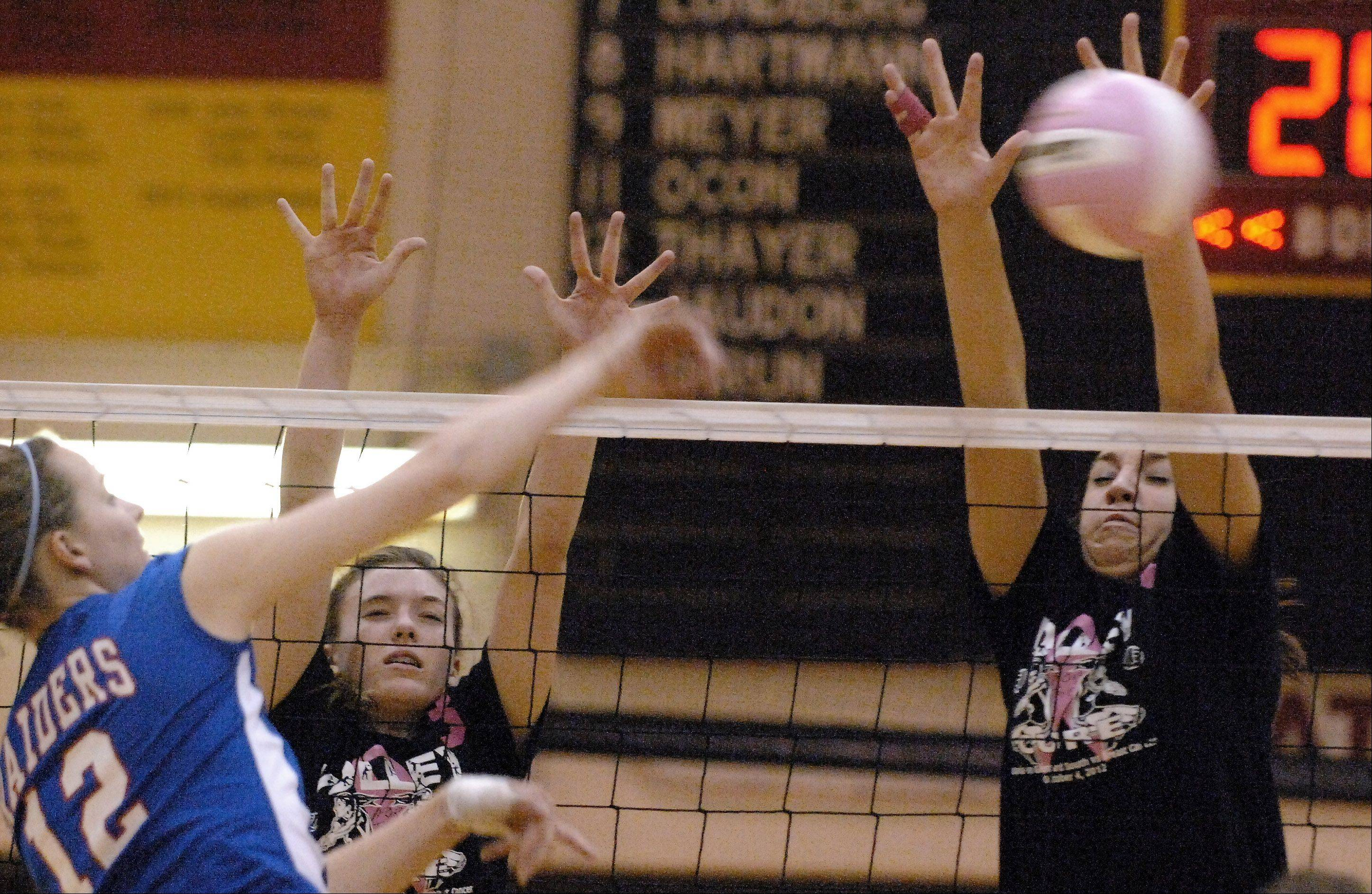 Batavia's Kristen Koncelik blocks a shot by Glenbard South's Anna Watterson during Thursday's game at Batavia.