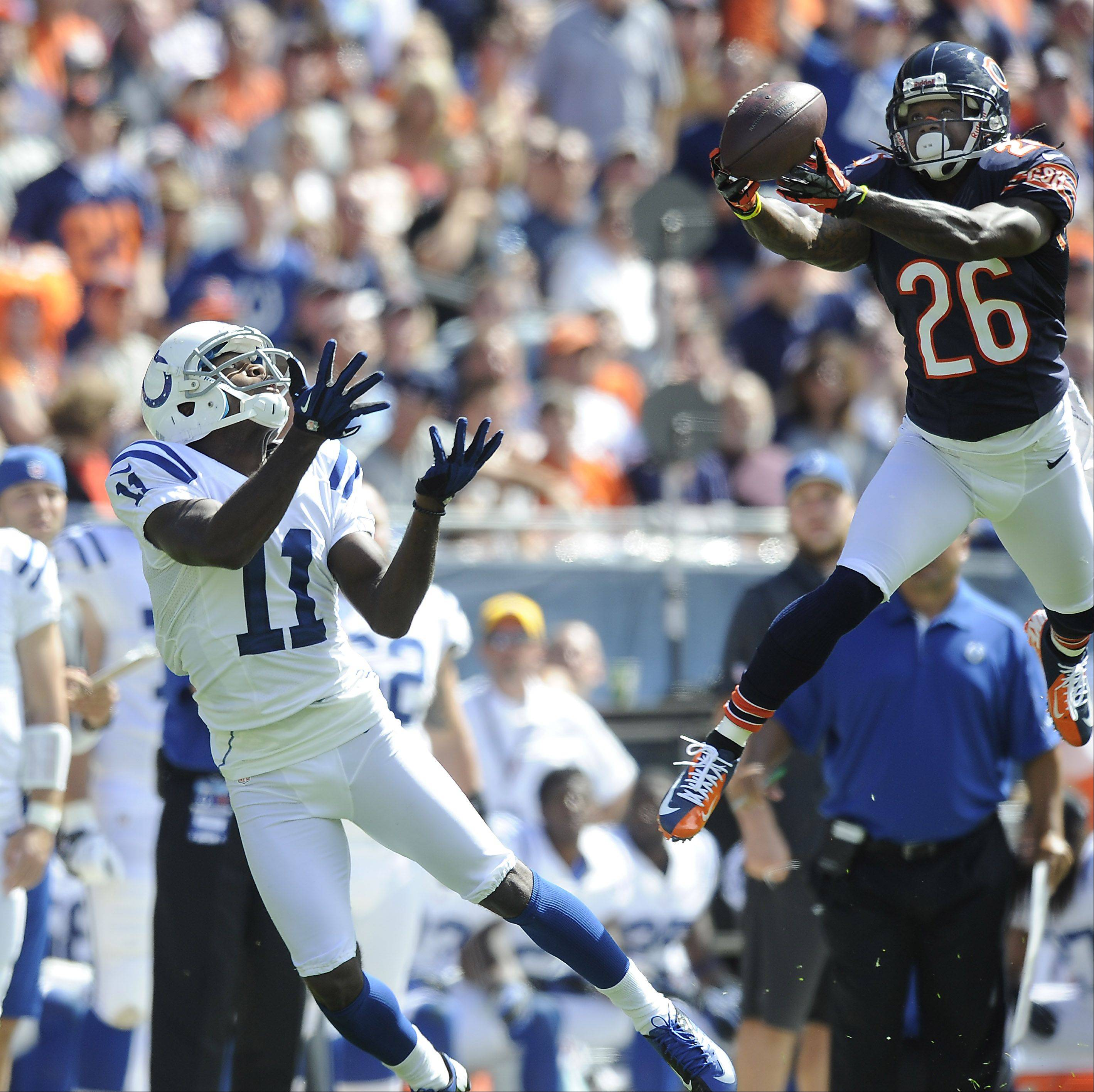 Chicago Bears defensive back Tim Jennings makes a finger tip interception and takes it away from intended receiver Donnie Avery in the Bears home opener at Soldier Field. Jennings was named NFC Defensive Player of the Month for September.