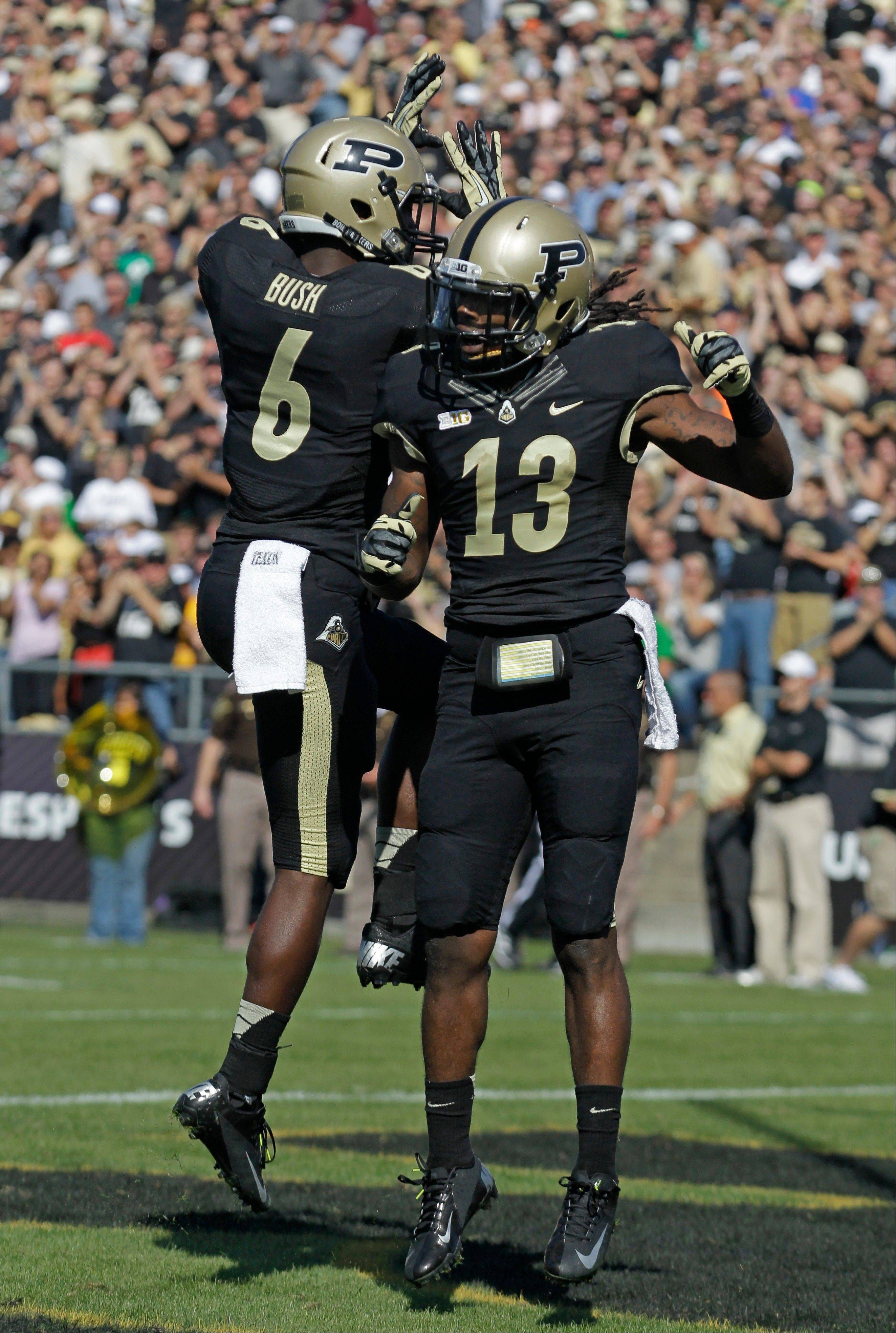 Purdue's Antavian Edison celebrates with Gary Bush after scoring a touchdown against Marshall last Saturday in West Lafayette, Ind.