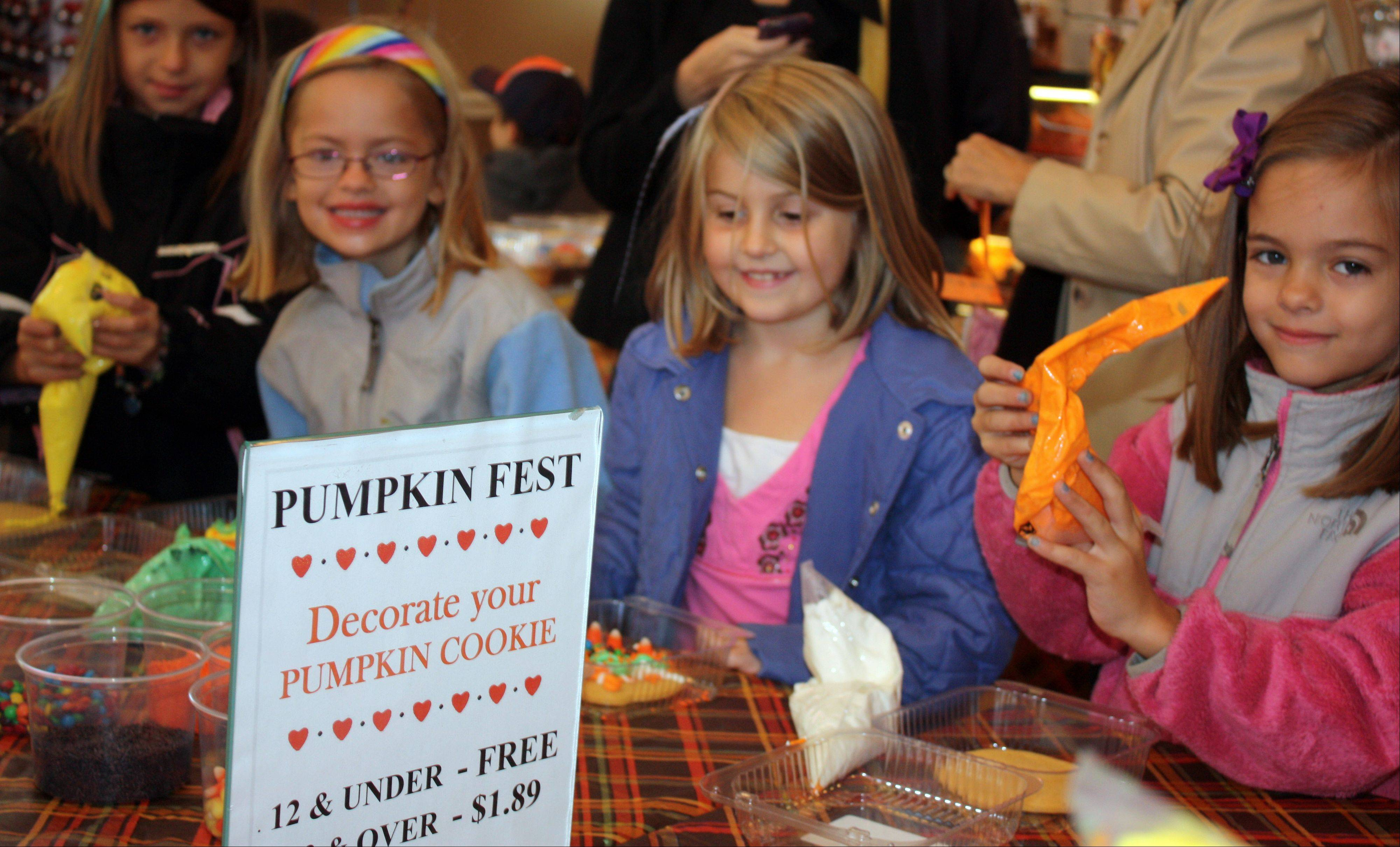 Children decorate cookies at last year's PumpkinFest, presented by the Libertyville Junior Woman's Club. This year's fest is Saturday, Oct. 13.