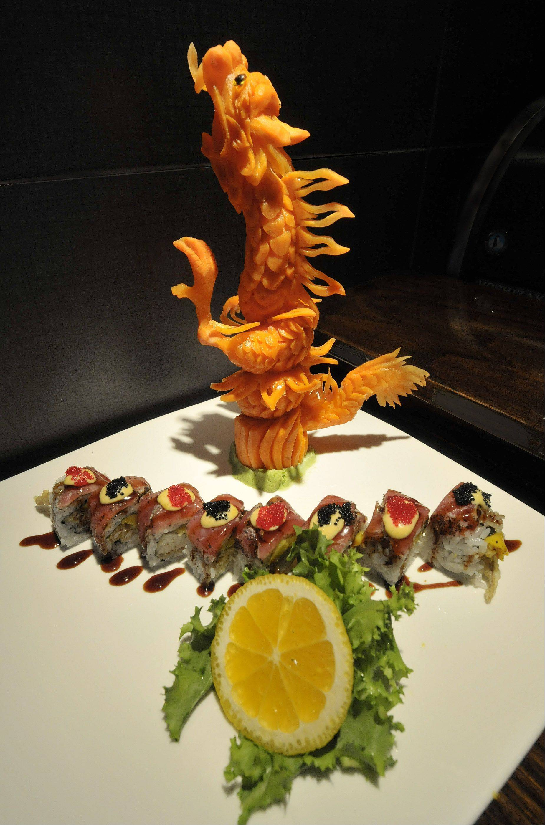 A variety of sushi creations are on the menu at Dao Sushi & Thai in Oakbrook Terrace. This is the Blackhawks Roll, with a dragon carved from carrots in the background.