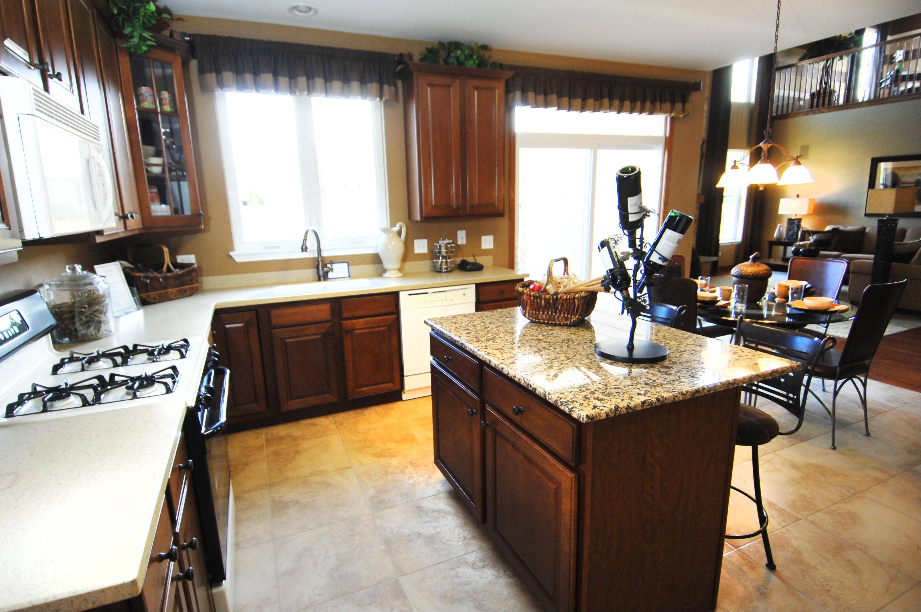 The kitchen of the Madison model in Liberty Trails in McHenry opens to the living space.