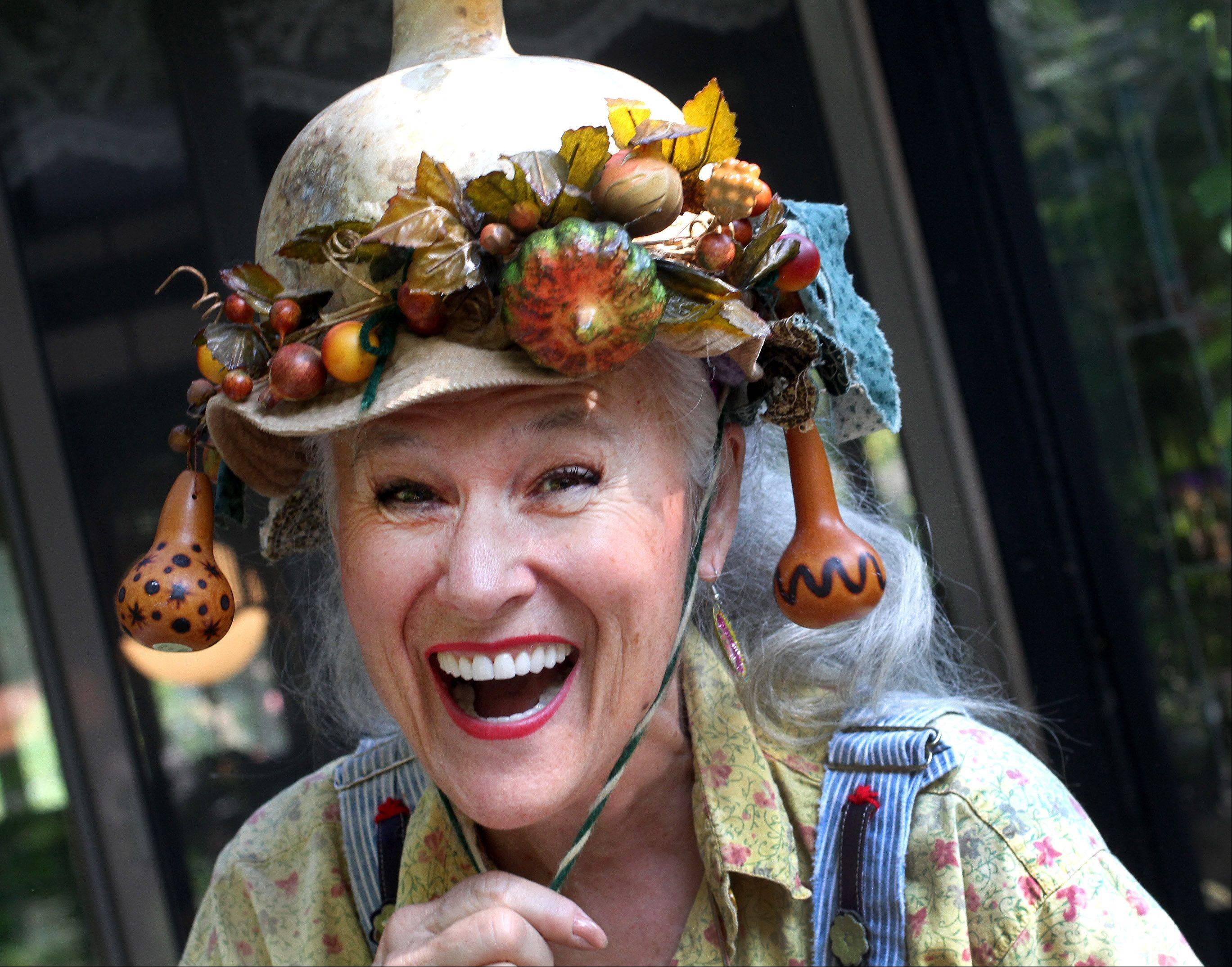 Carolyn Lauing-Finzer of Naperville describes herself as fun and eclectic. Here she dons a gourd hat.