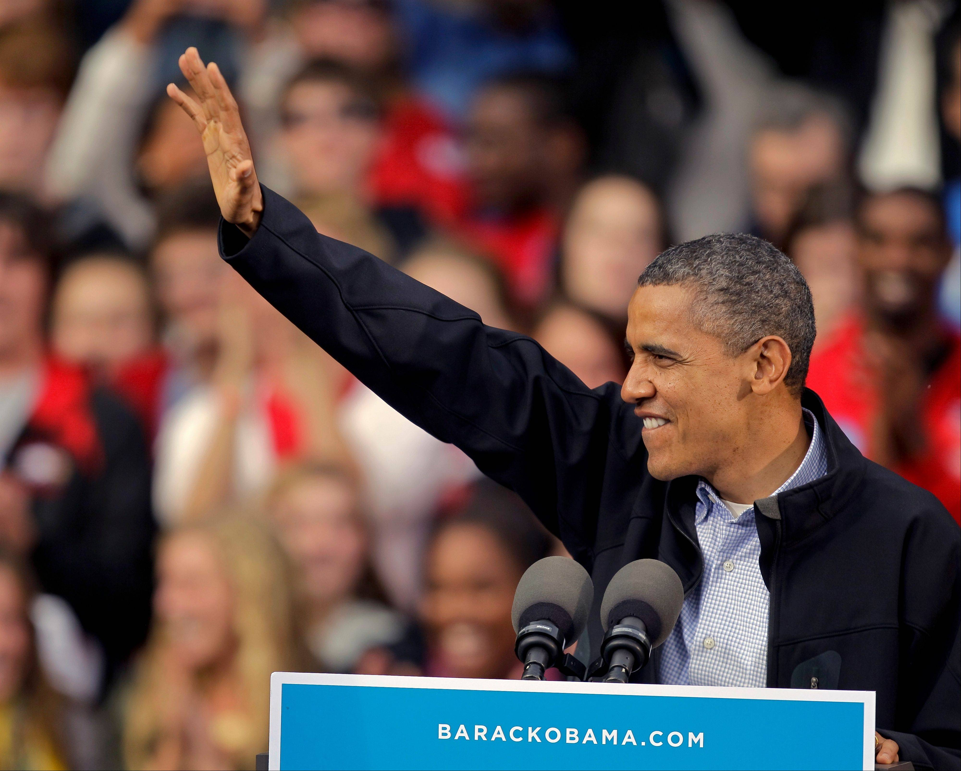 President Barack Obama acknowledges supporters at a campaign stop Thursday, Oct. 4, 2012, at the University of Wisconsin-Madison in Madison, Wis.