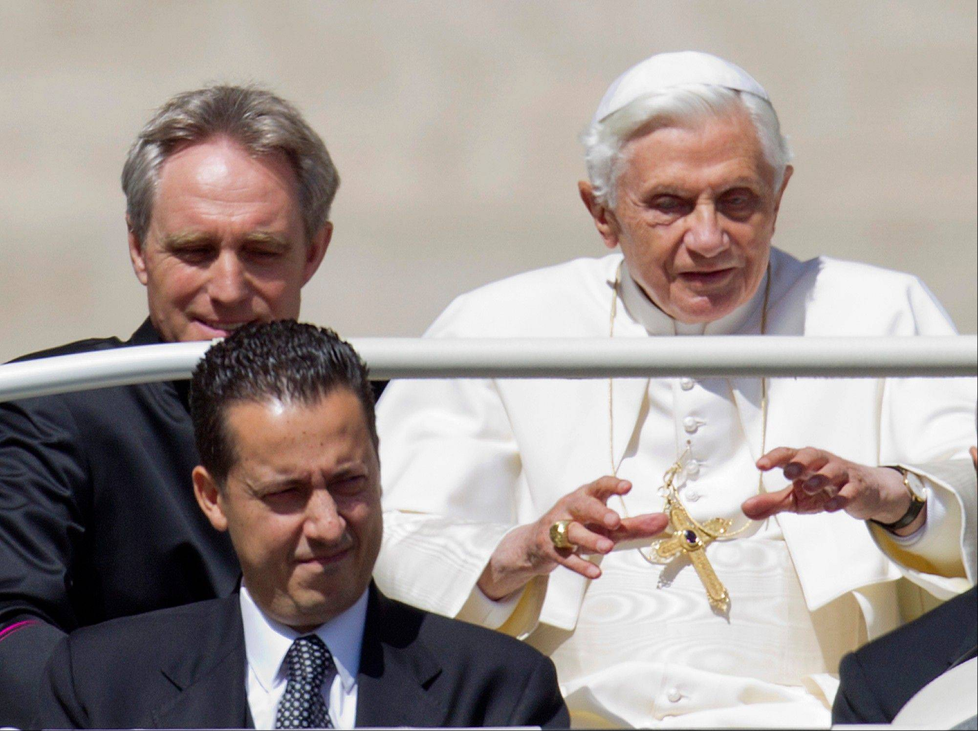 In this May photo, Pope Benedict XVI, flanked by his private secretary Georg Gaenswein, top left, and his butler Paolo Gabiele arrives at St. Peter�s square. A three-judge Vatican tribunal on Saturday will decide whether Paolo Gabriele is guilty of aggravated theft, accused of stealing the pope�s private papers and leaking them to journalist Gianluigi Nuzzi.