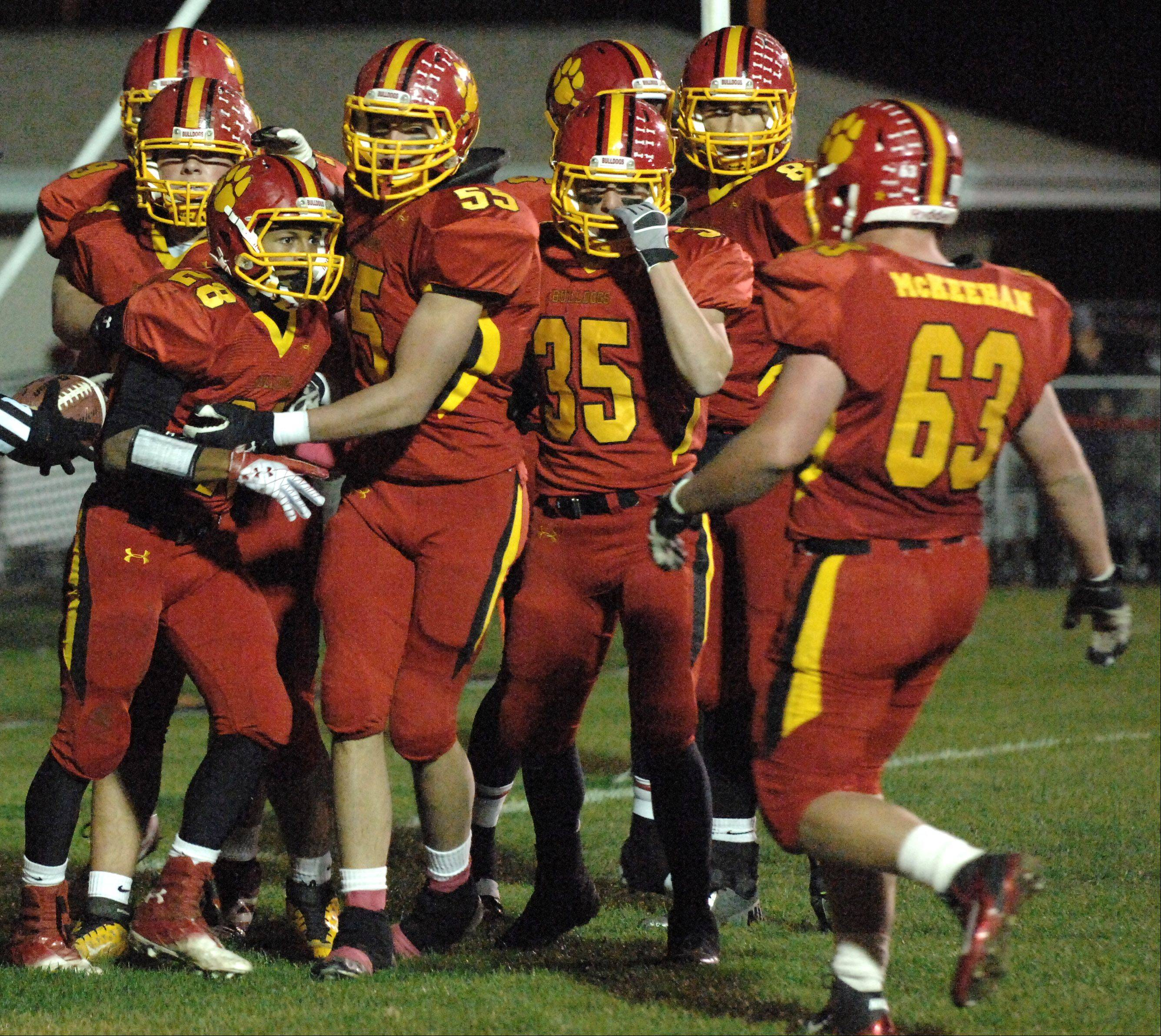 Batavia teammates congratulate Anthony Scaccia (28) after a third quarter touchdown during Friday�s game at Batavia.