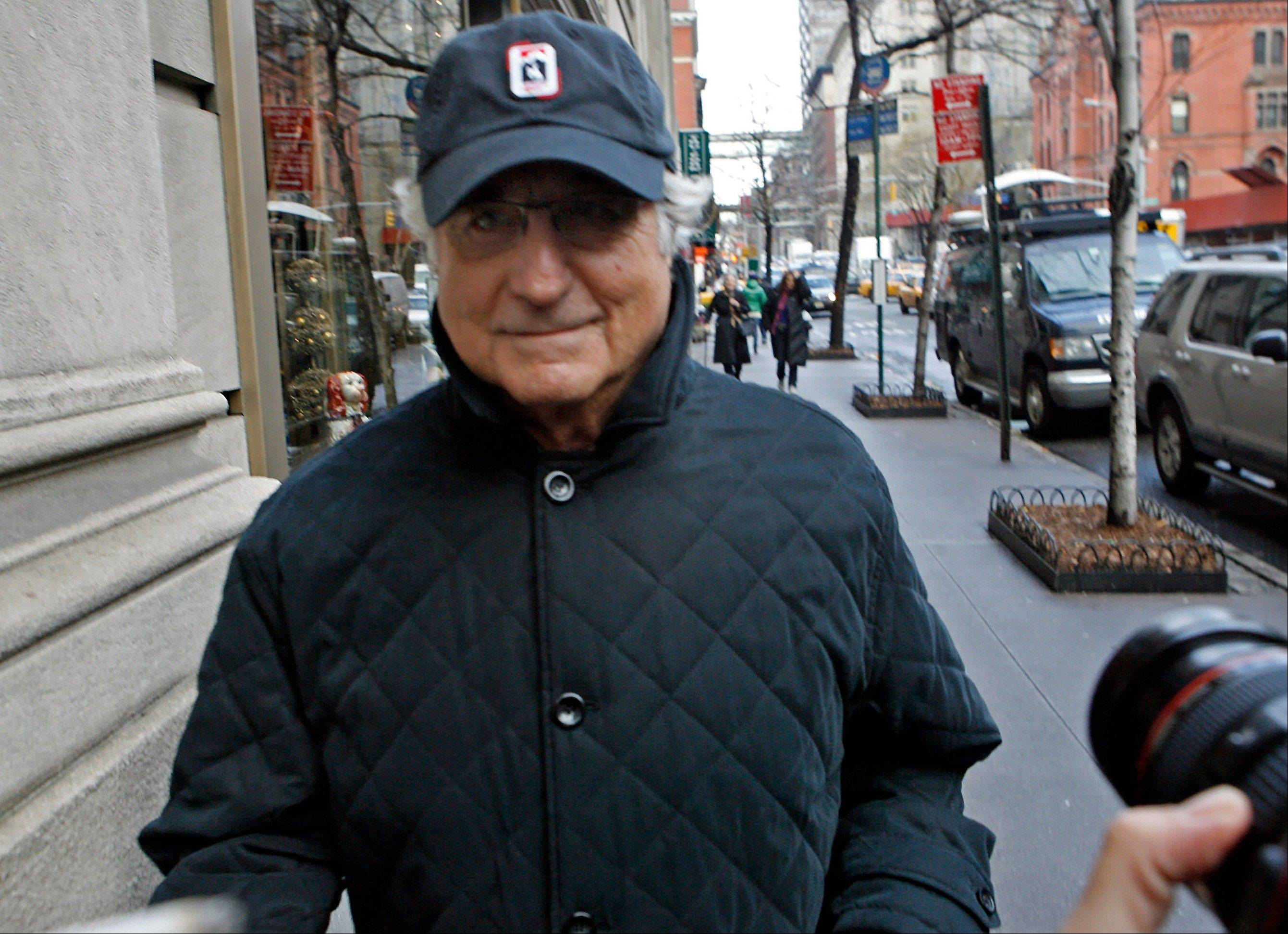 In December 2008, two of Bernard Madoff's most loyal employees met on a Manhattan street corner and fretted over a closely held secret that the rest of the world would learn about eight days later: that their boss, Madoff, was a con man for the ages. The exchange was recounted for the first time in a newly rewritten indictment this week expanding the case and charges against five defendants headed for a trial next year.