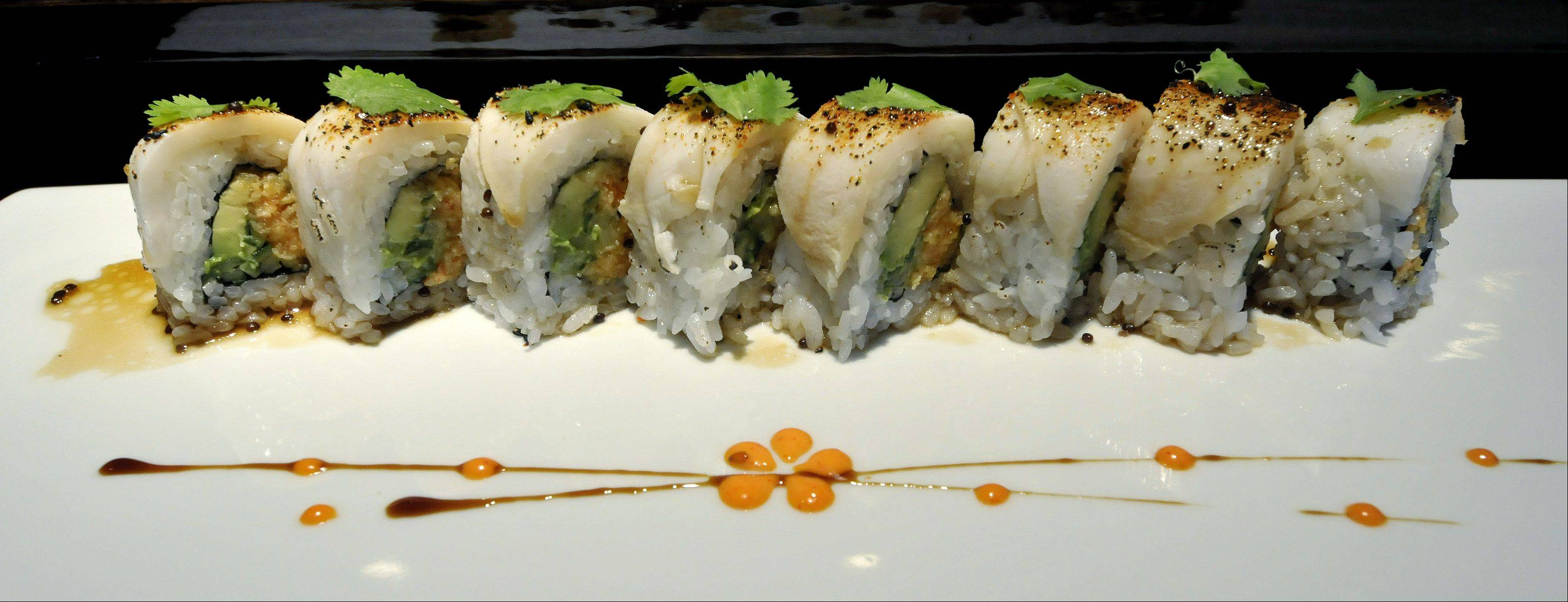 Stuffed with Cajun king crab, creamy avocado and cucumber, the White Sox Roll is crowned with spicy white tuna and cilantro.