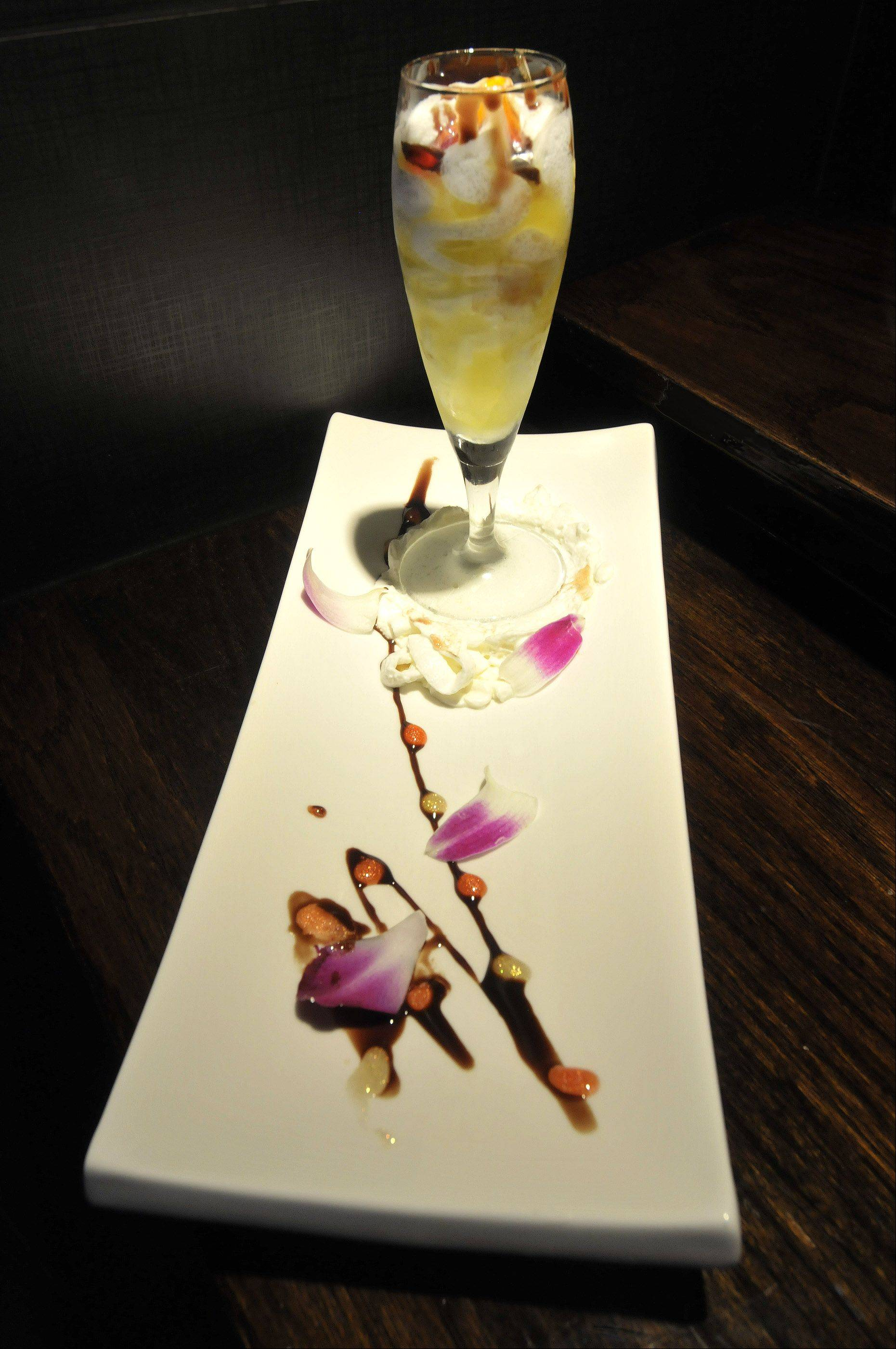 Scott Sanders/ssanders@dailyherald.comThe refreshing limoncello finale combines lemon gelato and limoncello in a champagne flute.