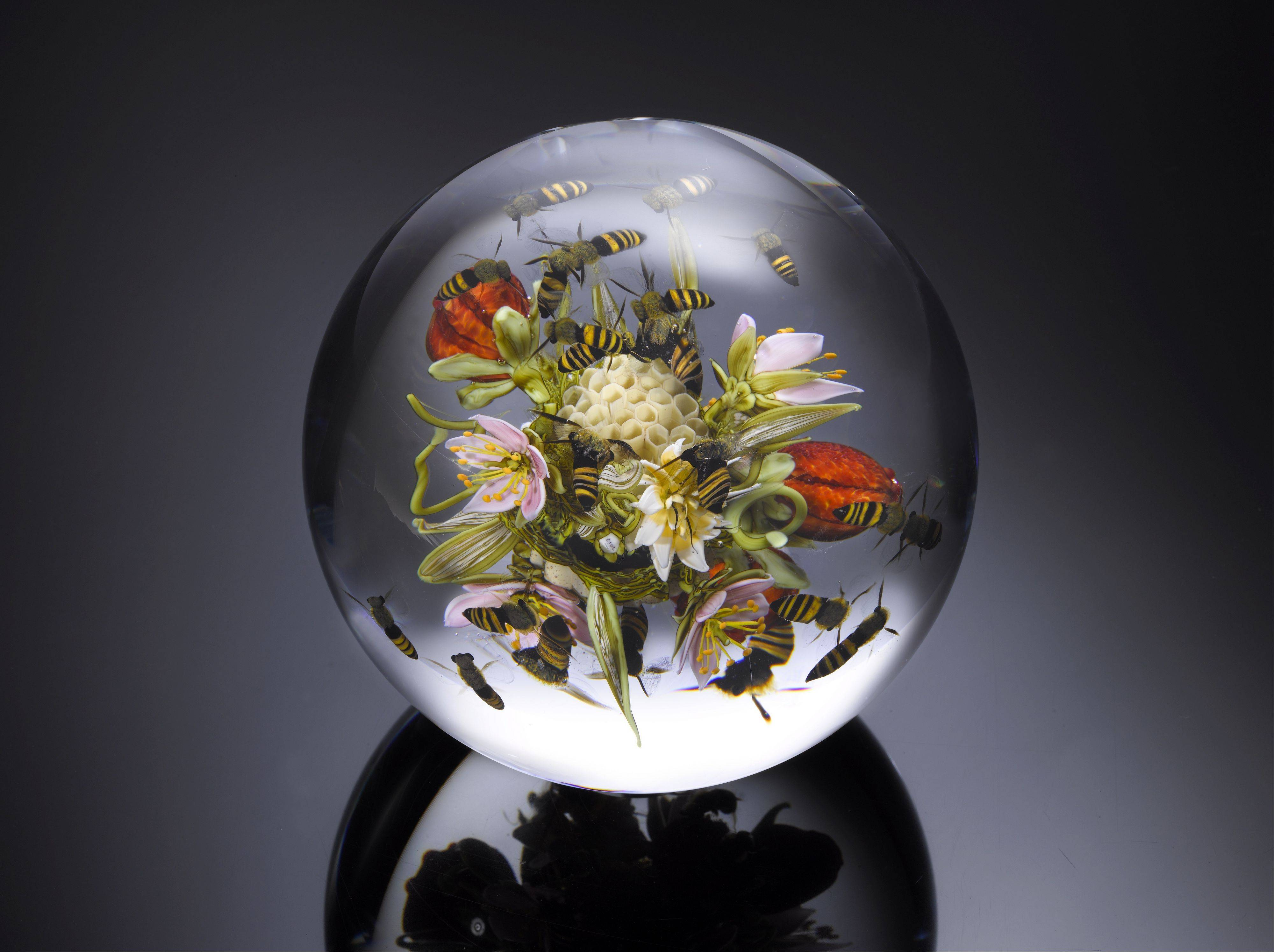 "A floral-filled paperweight by renowned paperweight artist Paul Stankard was designed for the gallery reopening of the ""Arthur Rubloff Collection of Paperweights"" at The Art Institute of Chicago."