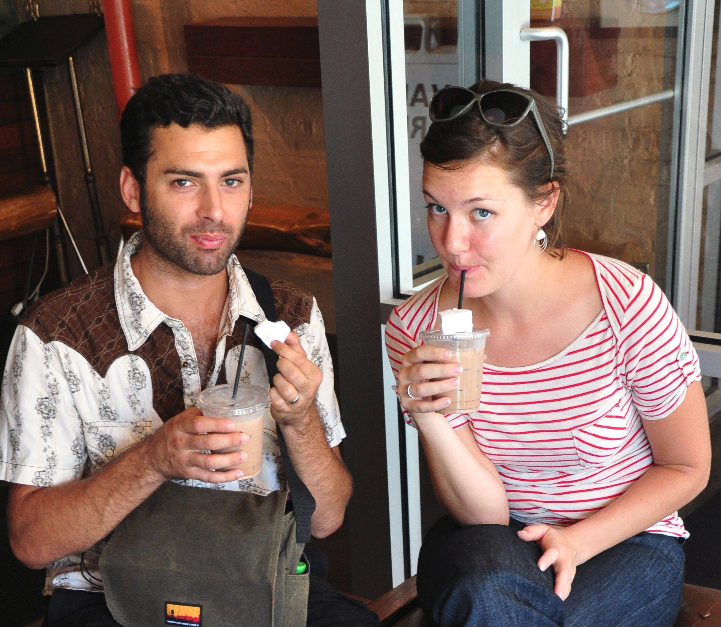 William and Mary Martin taste an iced chocolate with homemade marshmallow at HotChocolate restaurant and dessert bar.