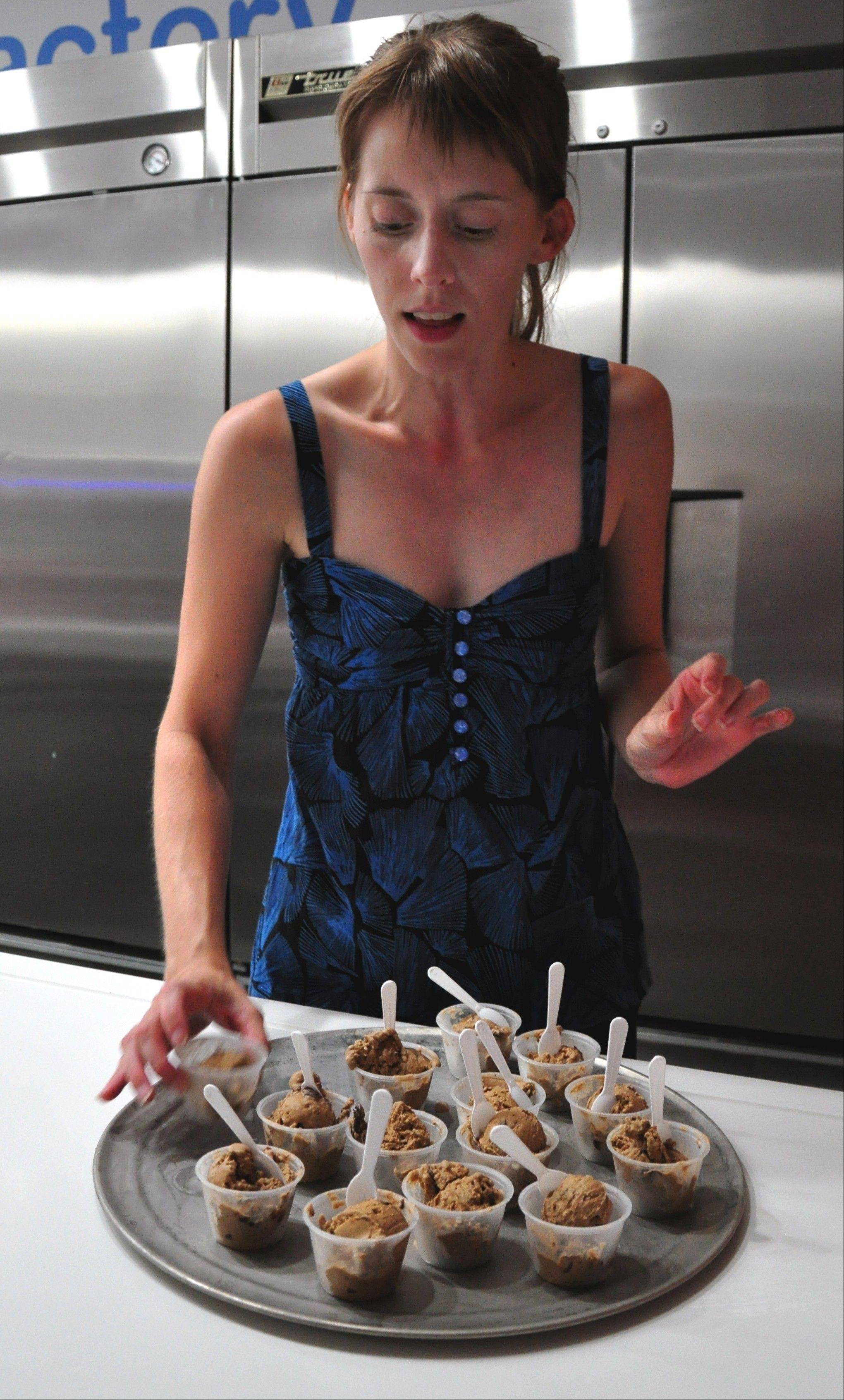 Tour guide Carrie Drapac readies samples of ice cream for food tour participants at iCream where frozen desserts are custom made using liquid nitrogen.