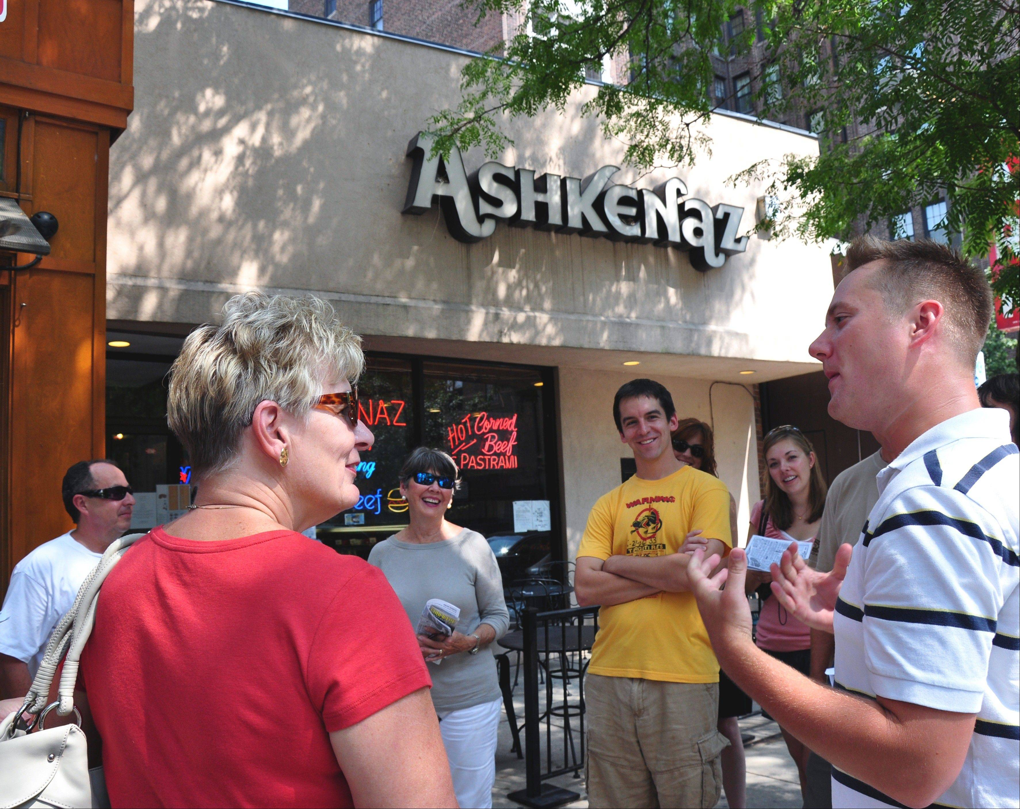 Tour guide Chris White gets a group ready for the Near North tour at Ashkenaz Deli, the first stop on the tour.