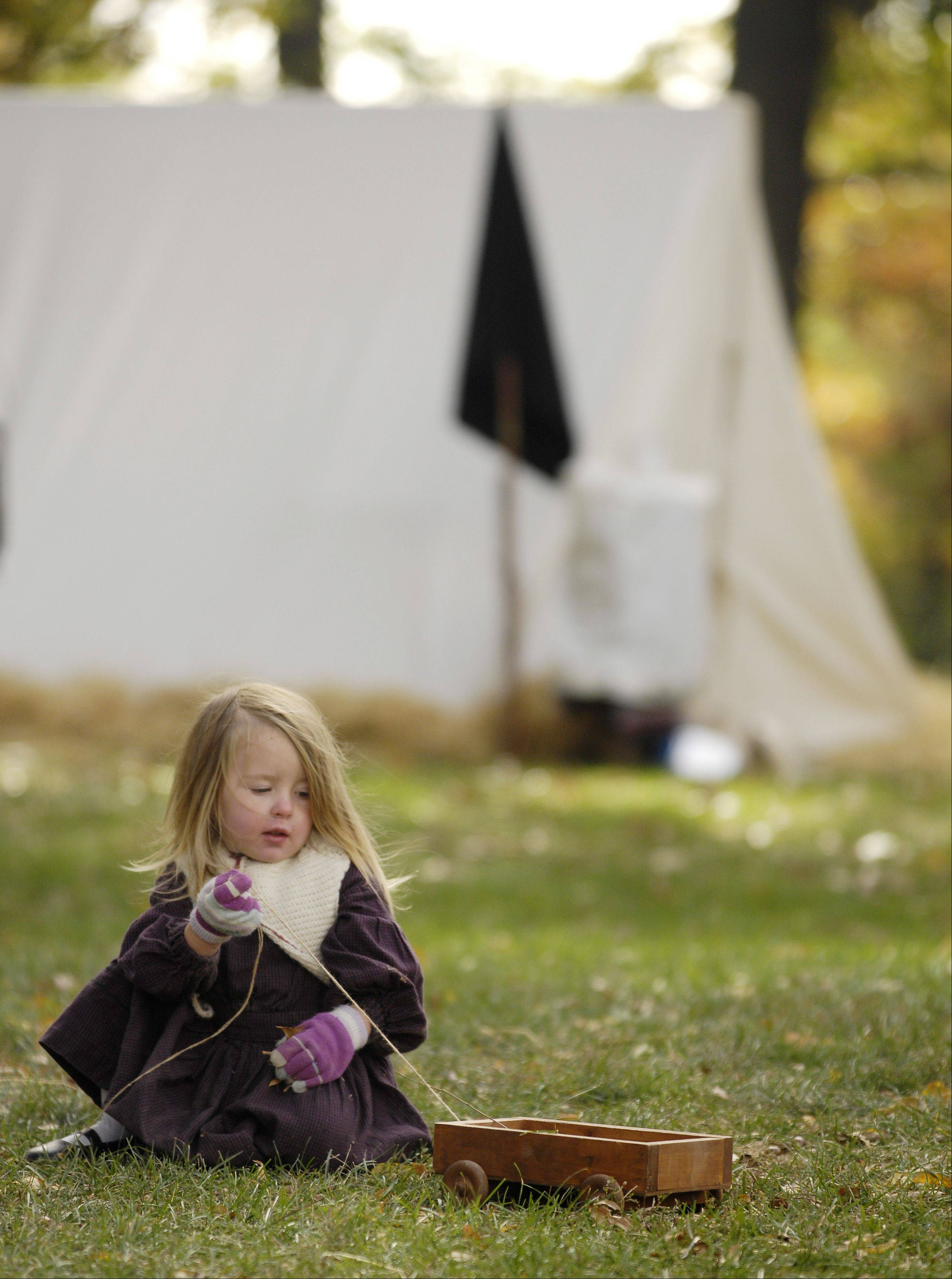Knox Burau, 2, of DeKalb, portrays a family member of the Missouri Gorillas in a Confederate Civil War Symposium and re-enactment Sunday at Cantigny Park in Wheaton.