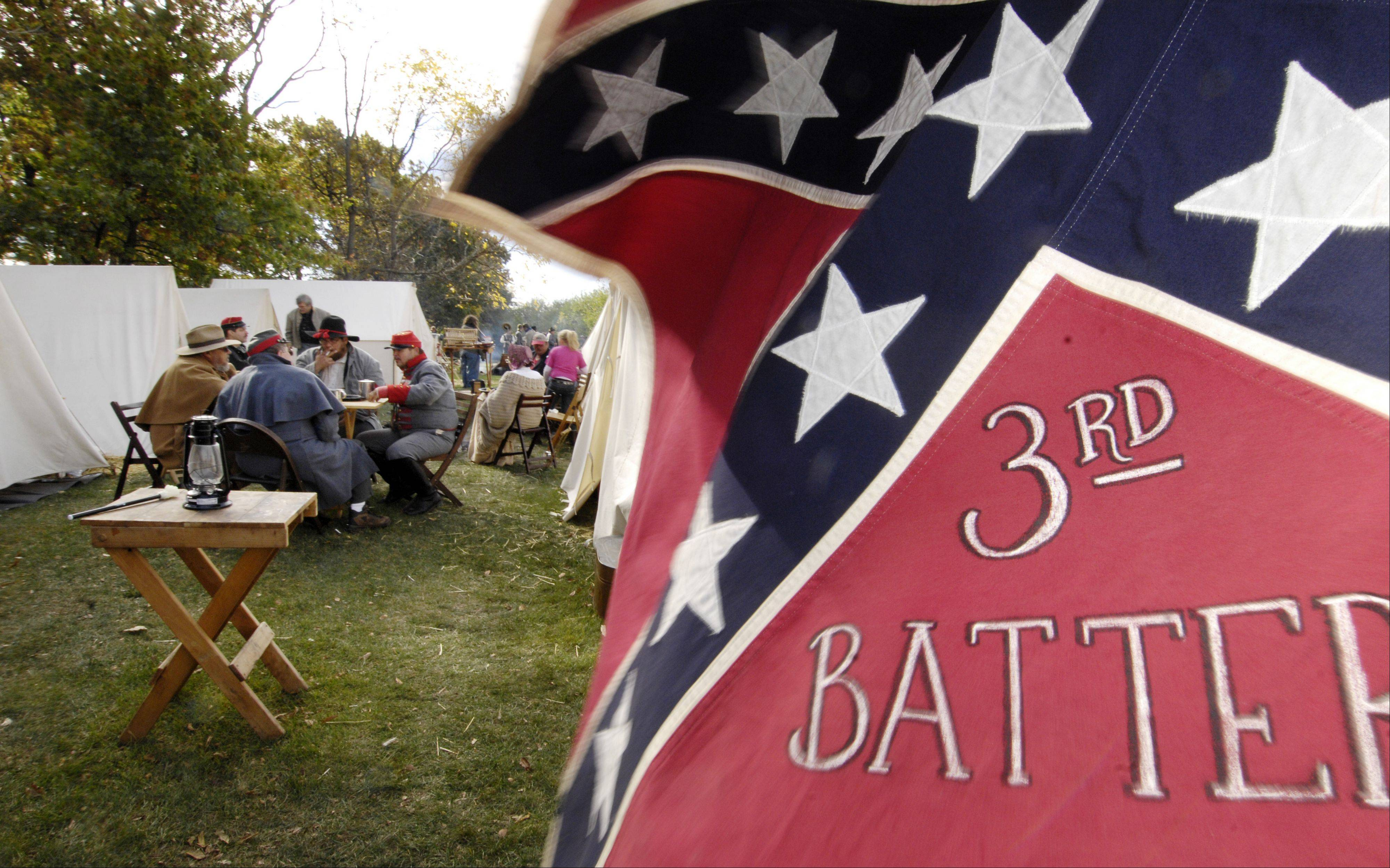 The Richmond 3rd Battery eats breakfast in the Civil War re-enactors camp Sunday at Cantigny Park in Wheaton.