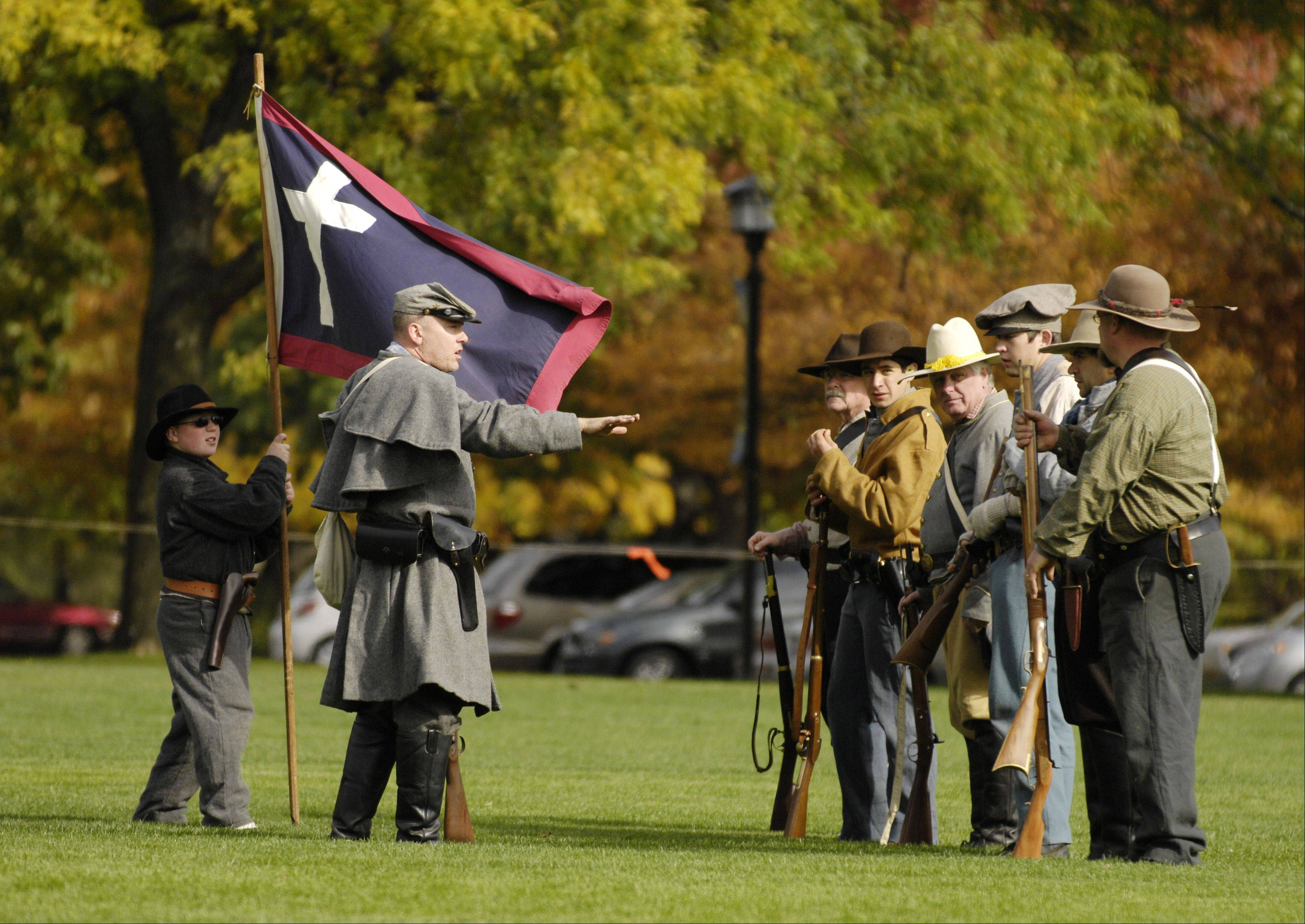 Member of the Confederate Missouri Gorillas perform drills during a Civil War re-enactors camp Sunday at Cantigny Park in Wheaton.