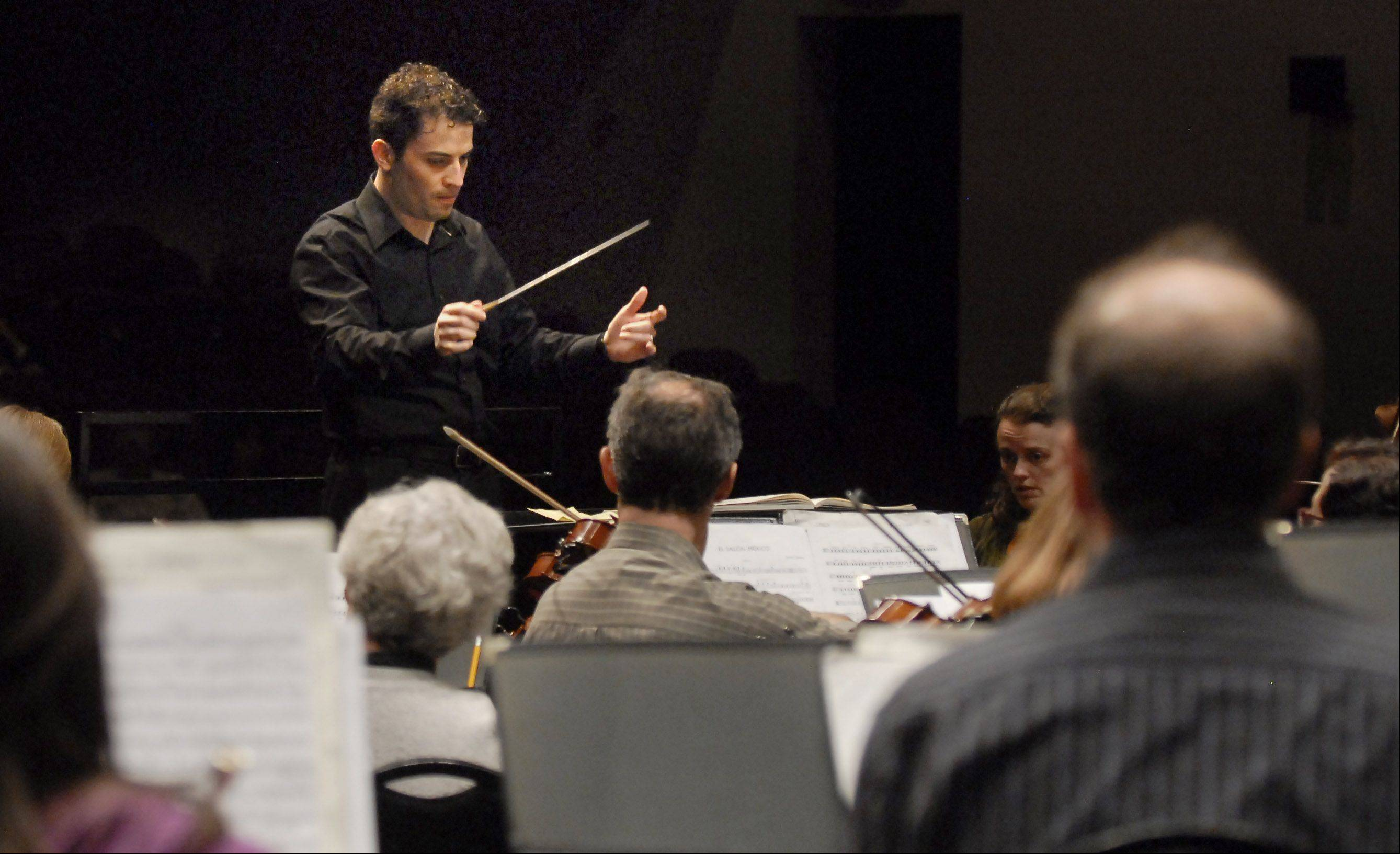 Elgin Symphony Orchestra guest conductor Andres Franco leads the orchestra during rehearsal after a behind-the-scenes event for Daily Herald Subscriber Total Access members.