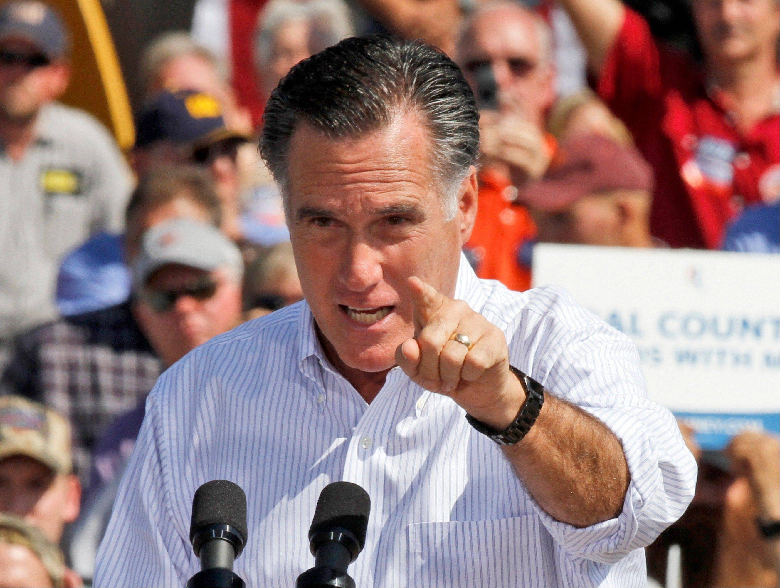 Republican presidential candidate and former Massachusetts Gov. Mitt Romney gestures Friday during a rally in Abingdon, Va.